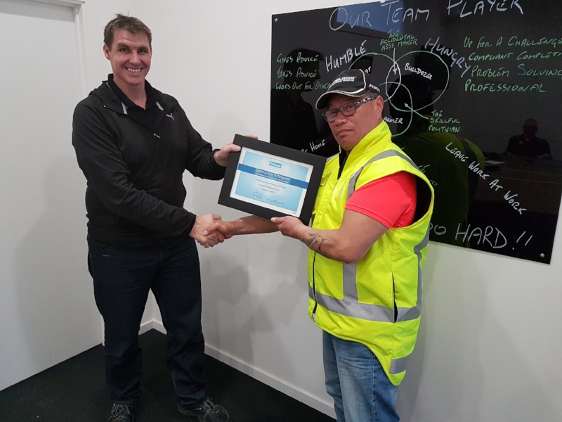 Jo (R) receiving his Promat Certificate from Tony
