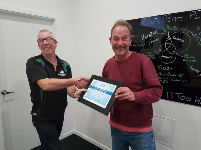 Bruce (R) receiving his Promat certificate from Phil