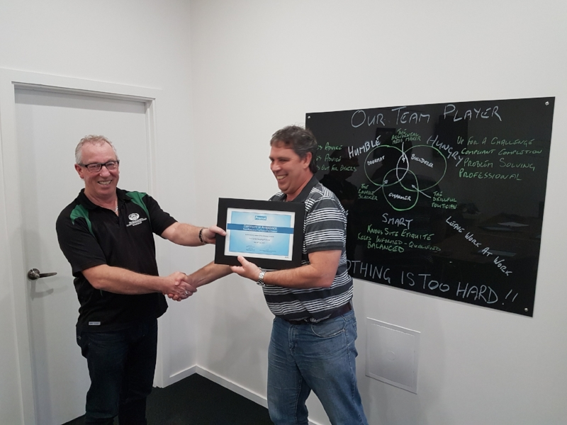 Philip (R) receiving his Promat certificate from Phil