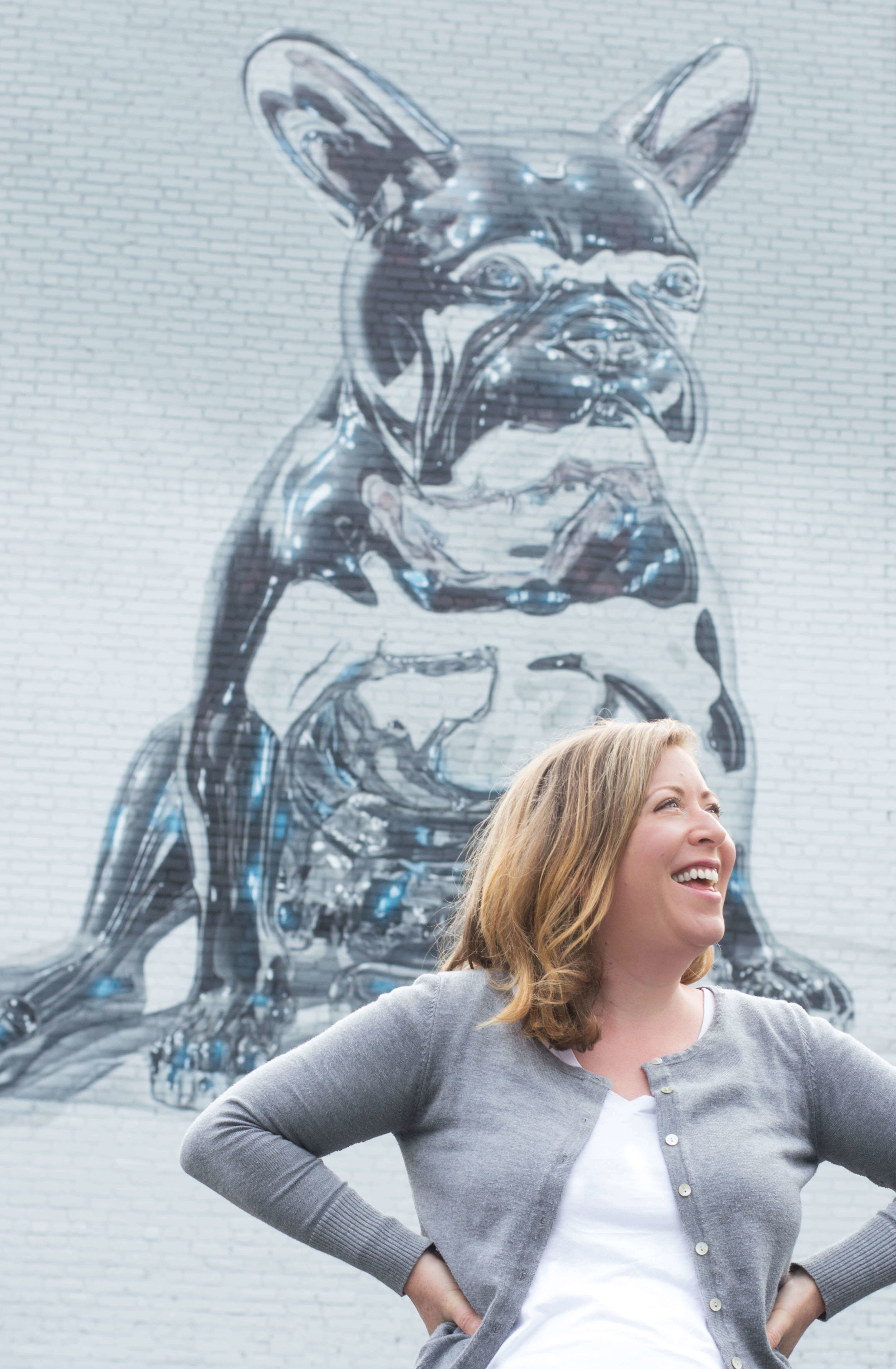 That's Zoë – - founder and ardent supporter of every single client. And that dog mural is even more amazing in person. Catch it at the Punto Urban Art Museum in Salem, Massachusetts.
