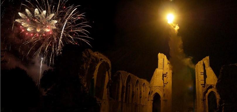 Glastonbury Extravaganza - A brilliant illuminating flare lit up the Abbey ruins like a rising sun