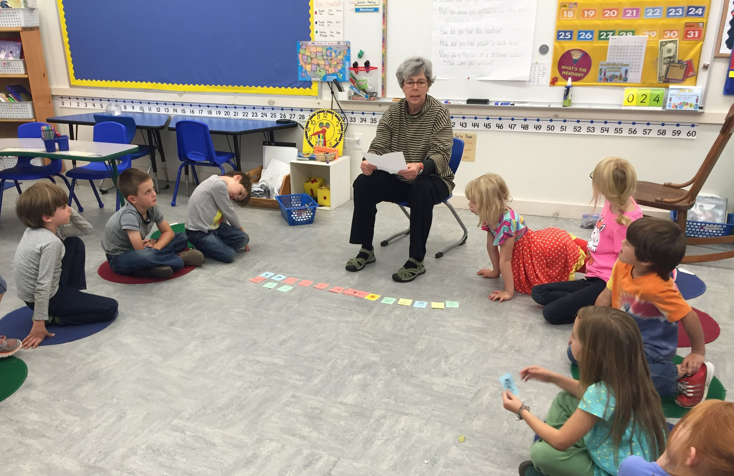 Founding teacher Mary Tracy works with a group of first graders.