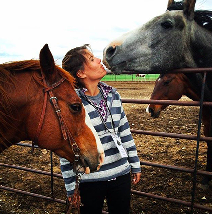 kristin with horses kissing.png