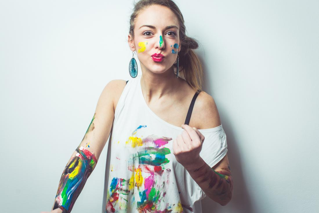 young-woman-having-fun-with-paints.jpg