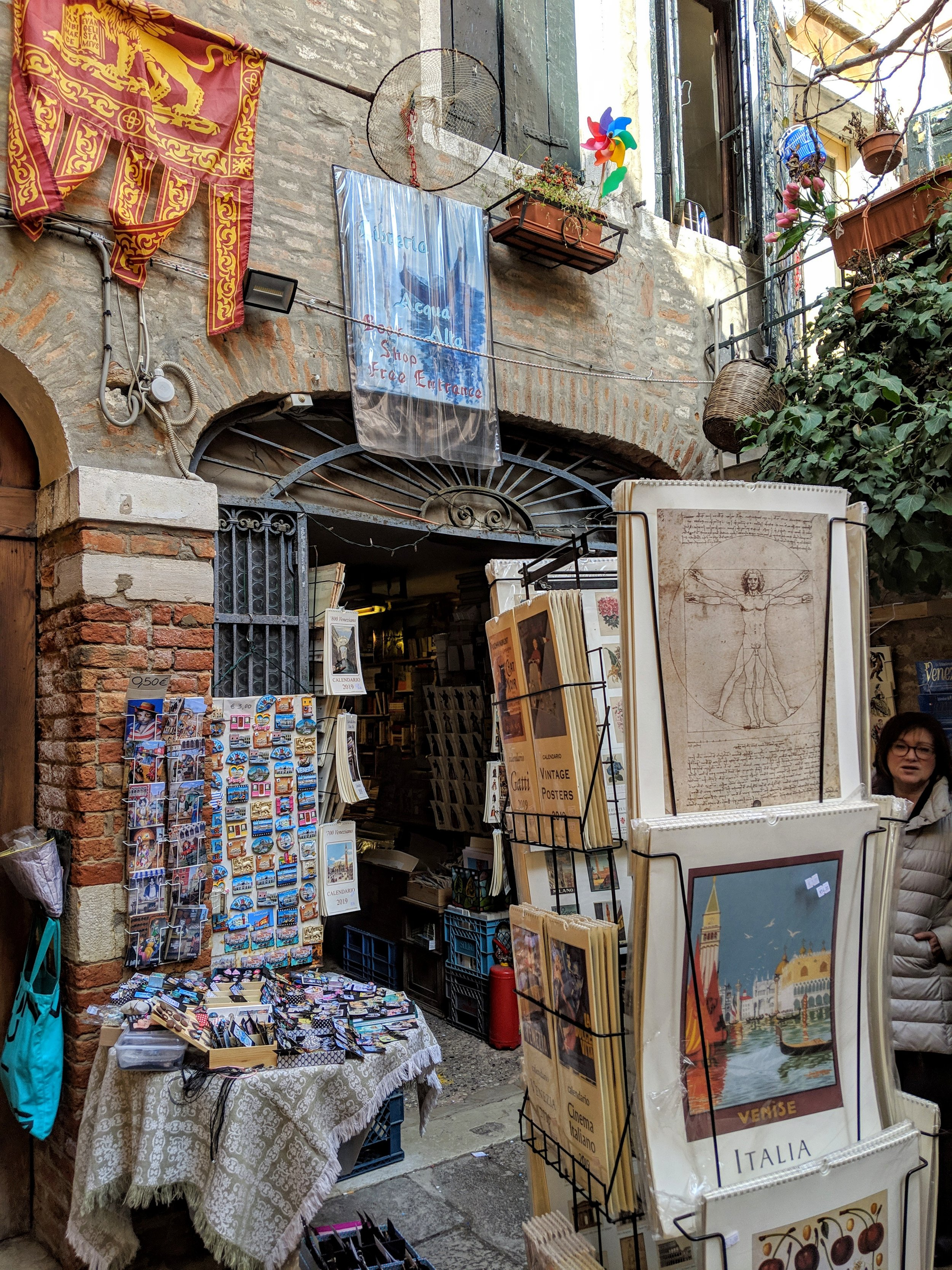 Libreria Acqua Alta Bookstore - Had you ever dreamed of reading Heaminguway's book with a view of a gondolier passing by? That's the spot. To save books from water damage, they keep it in bathtubs