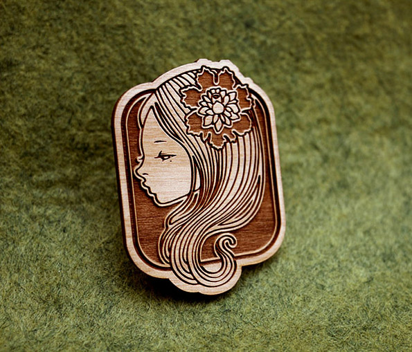 engraved wooden brooches. 2010.  limited edition of 1200.