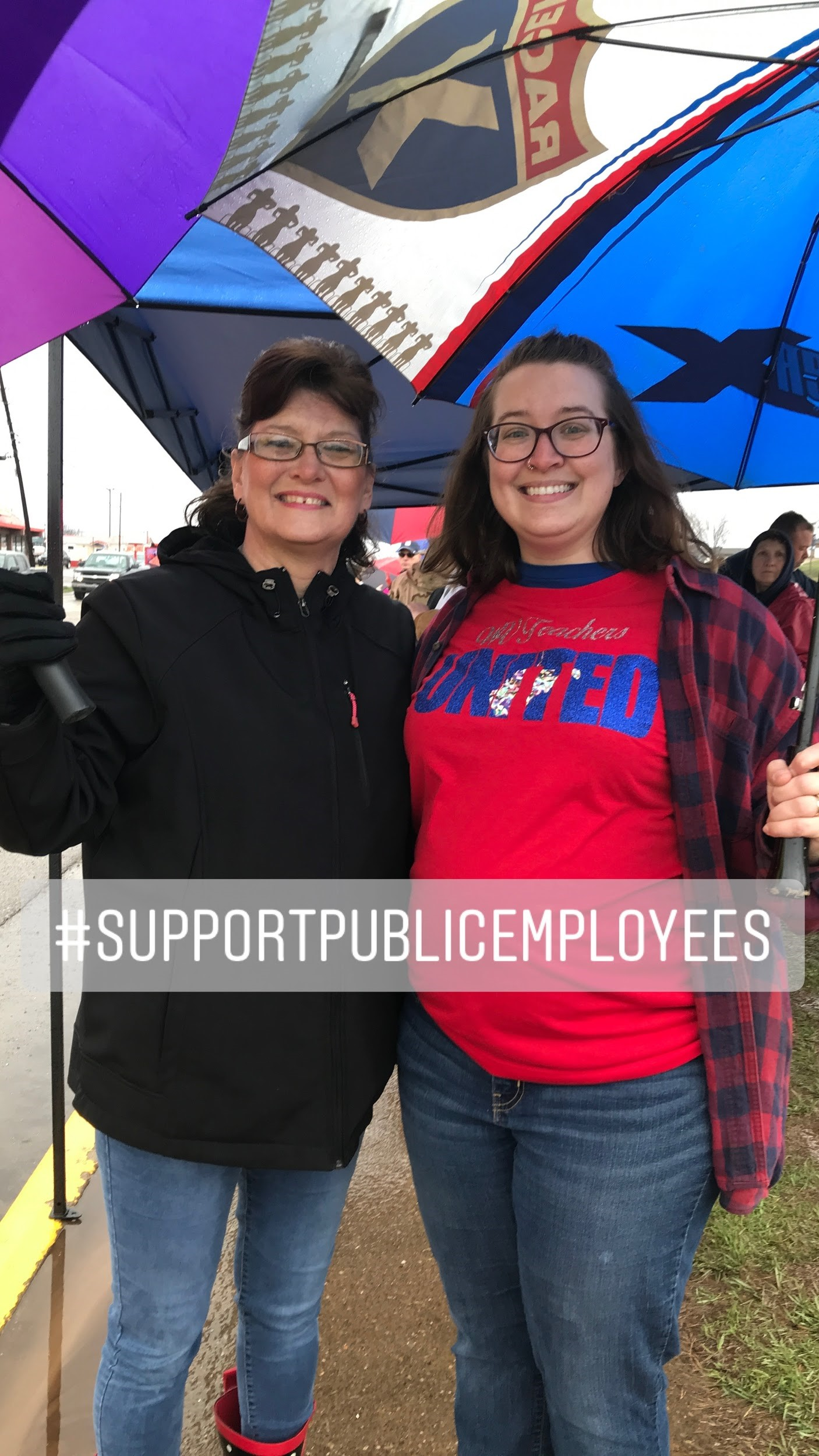 Jeanna Boston and Ashley Johnson in front of Parkersburg South High School during the work stoppage