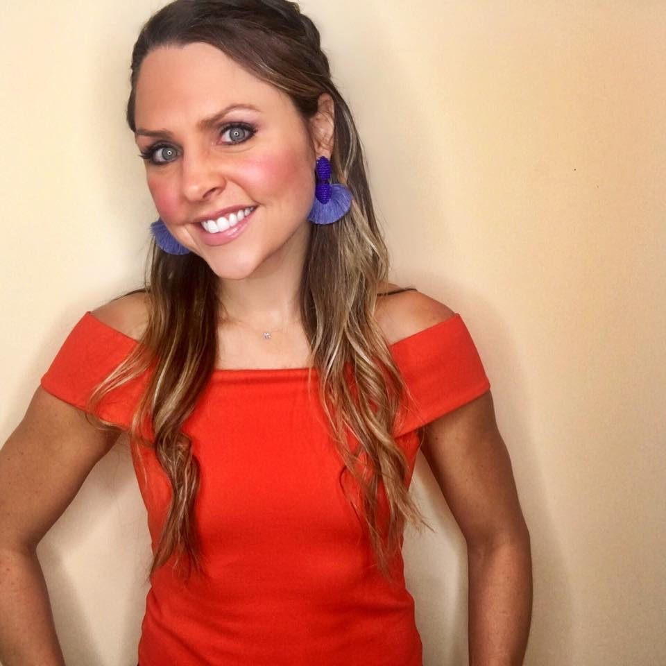 Look how  these blue earrings  make a real statement with this orange top! Bonus, they are on sale.