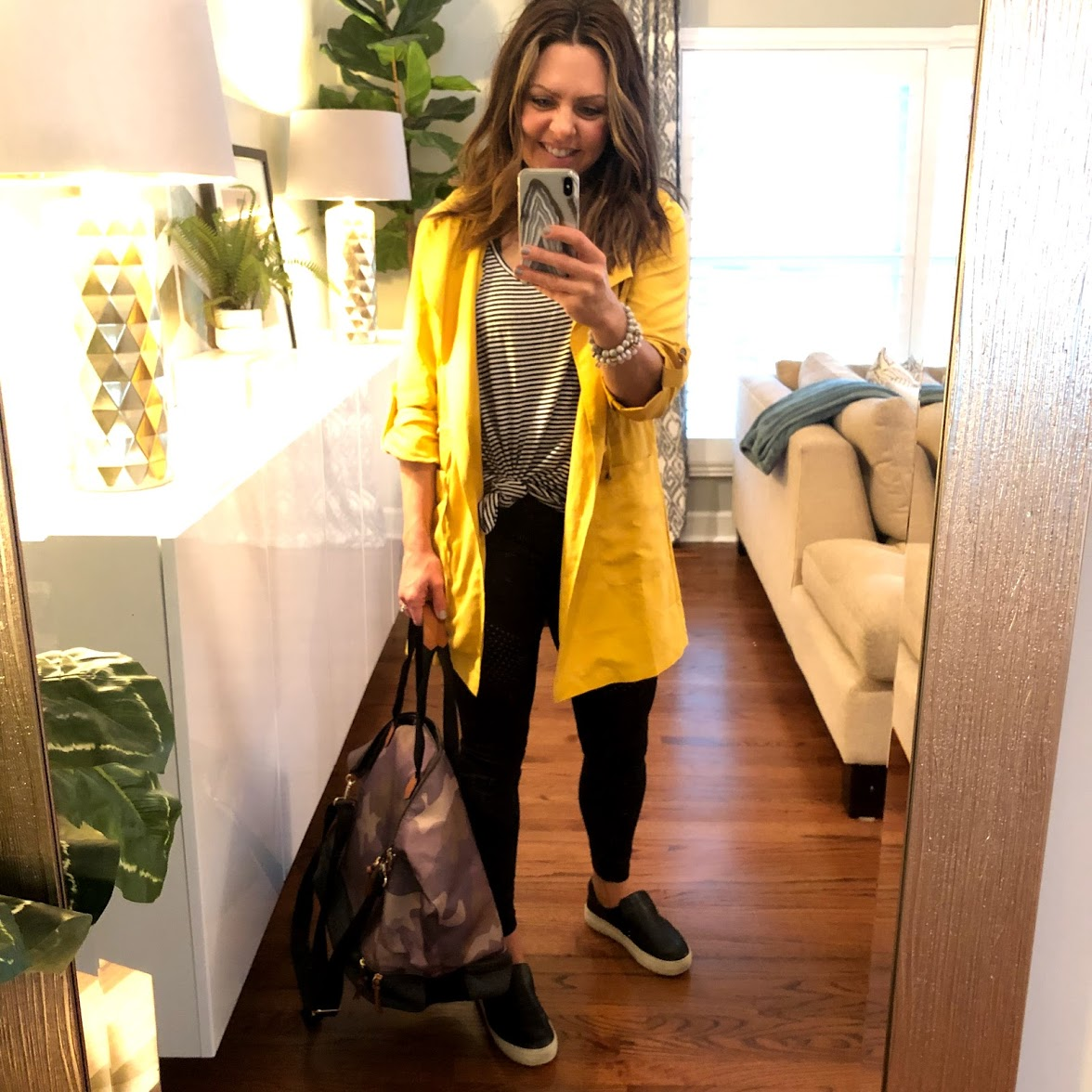 This is the outfit I wore for my flight today: Comfy versatile slide sneakers, black leggings, striped top, and yellow jacket.