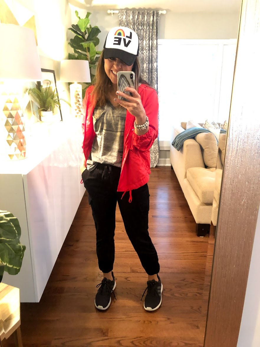 This outfit has all the elements: athletic shoes, black joggers, red windbreaker, camo tee shirt.