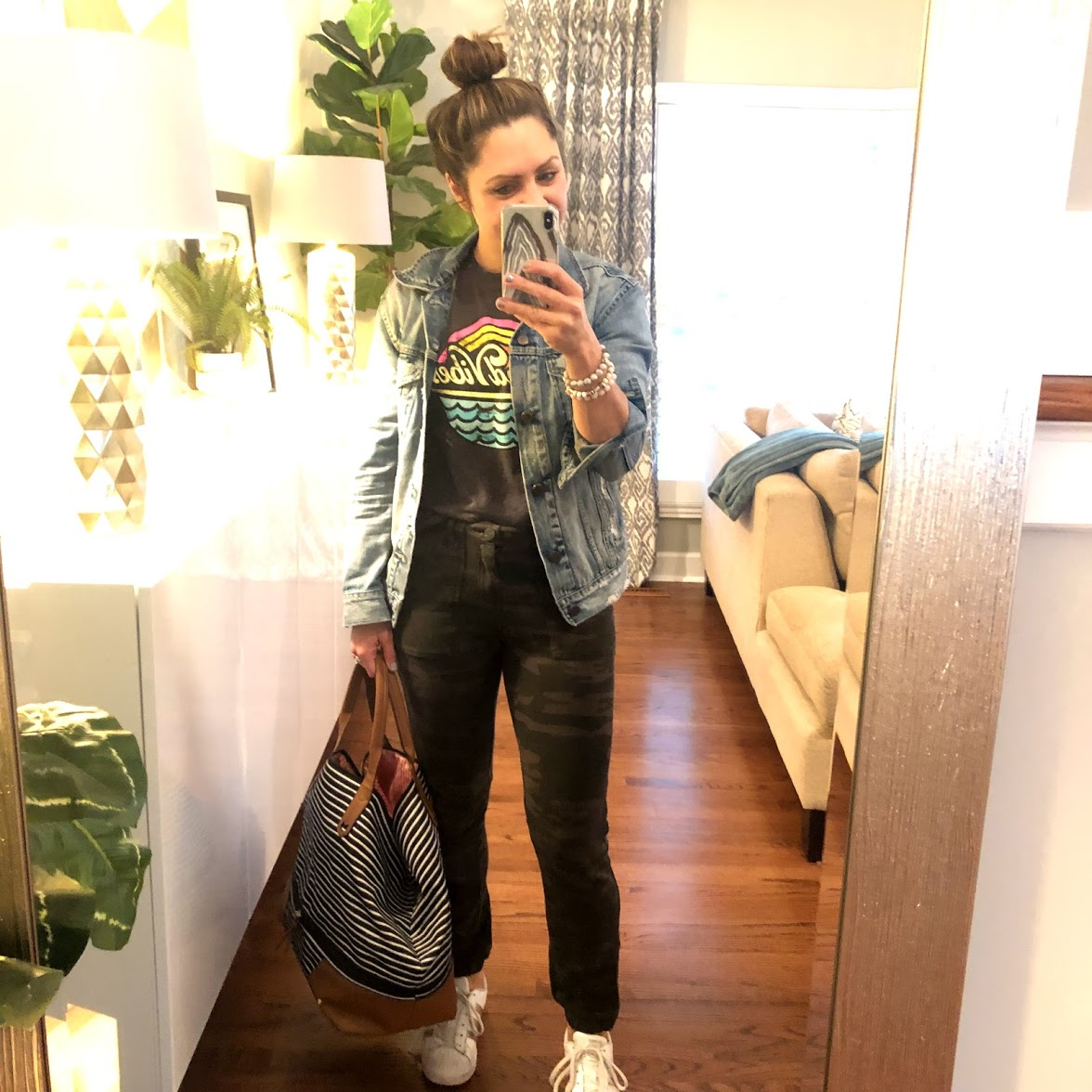 Camo joggers (they are like sweatpants!), Adidas sneakers, denim jacket, graphic tee.