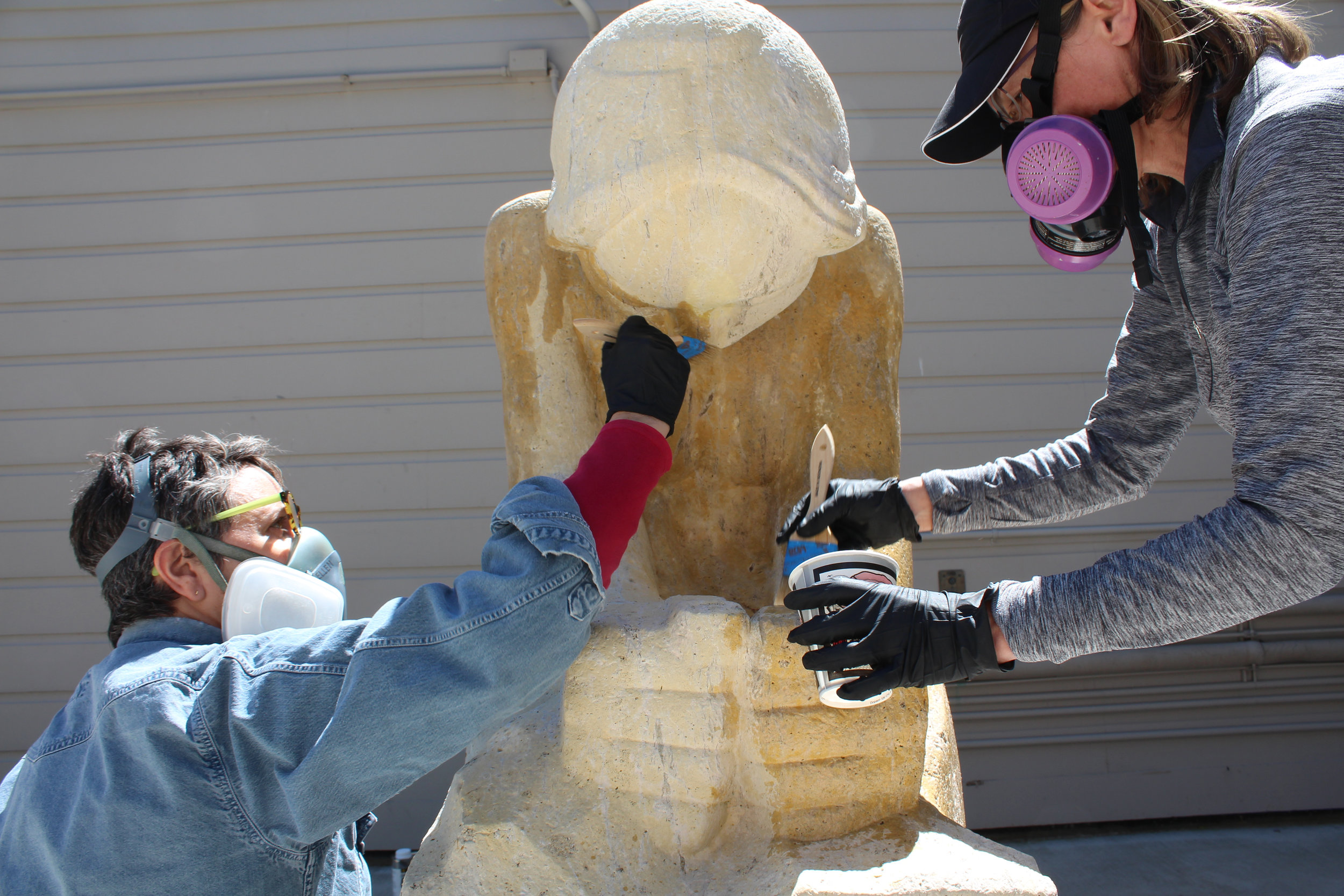 During treatment, applying stone consolidant
