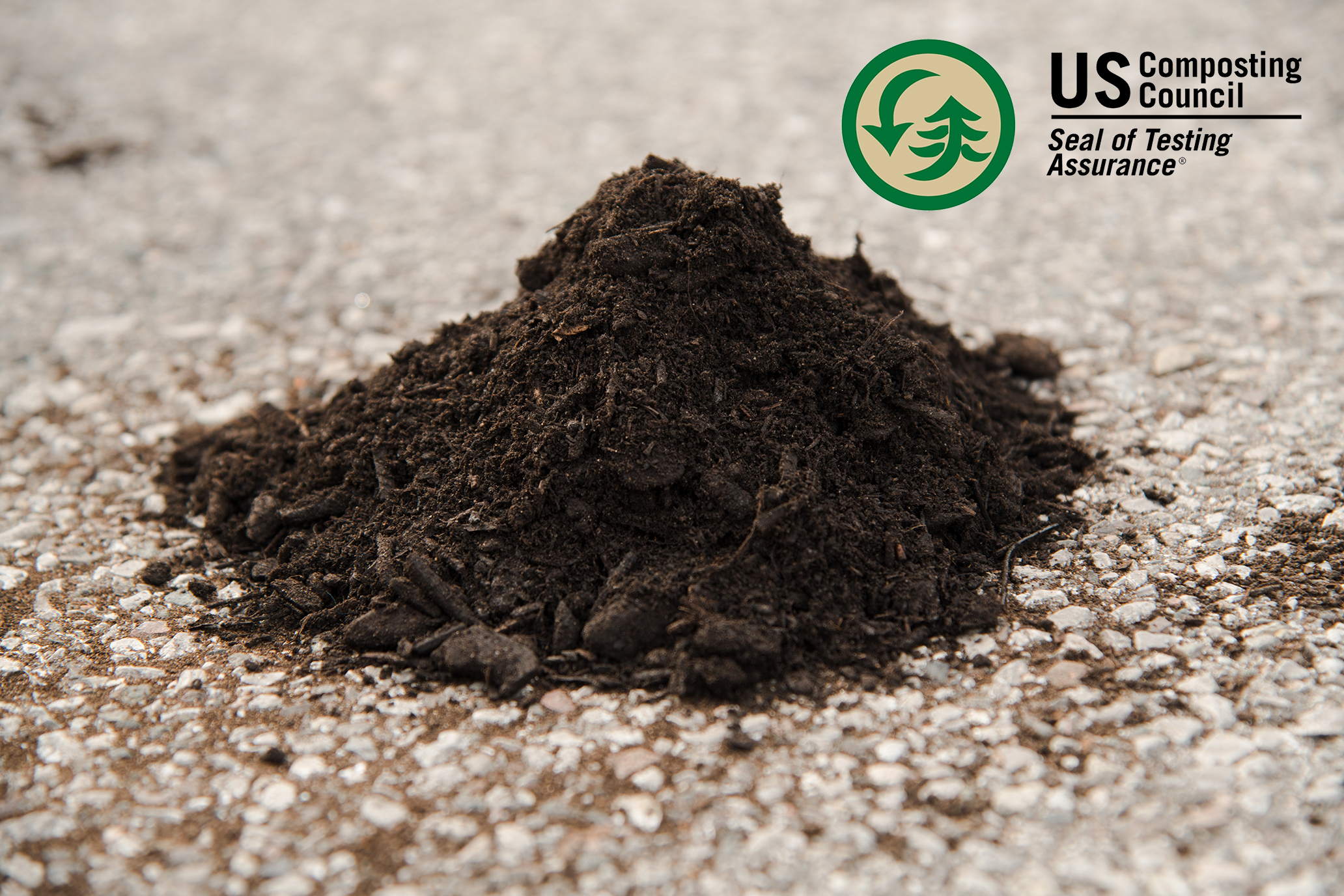 Natural Compost - A hearty, dark product consisting of fully composted green waste that is turned and processed through a trommel screen continually throughout the aging process. This compost holds the Seal of Testing Assurance from the US Composting Council.