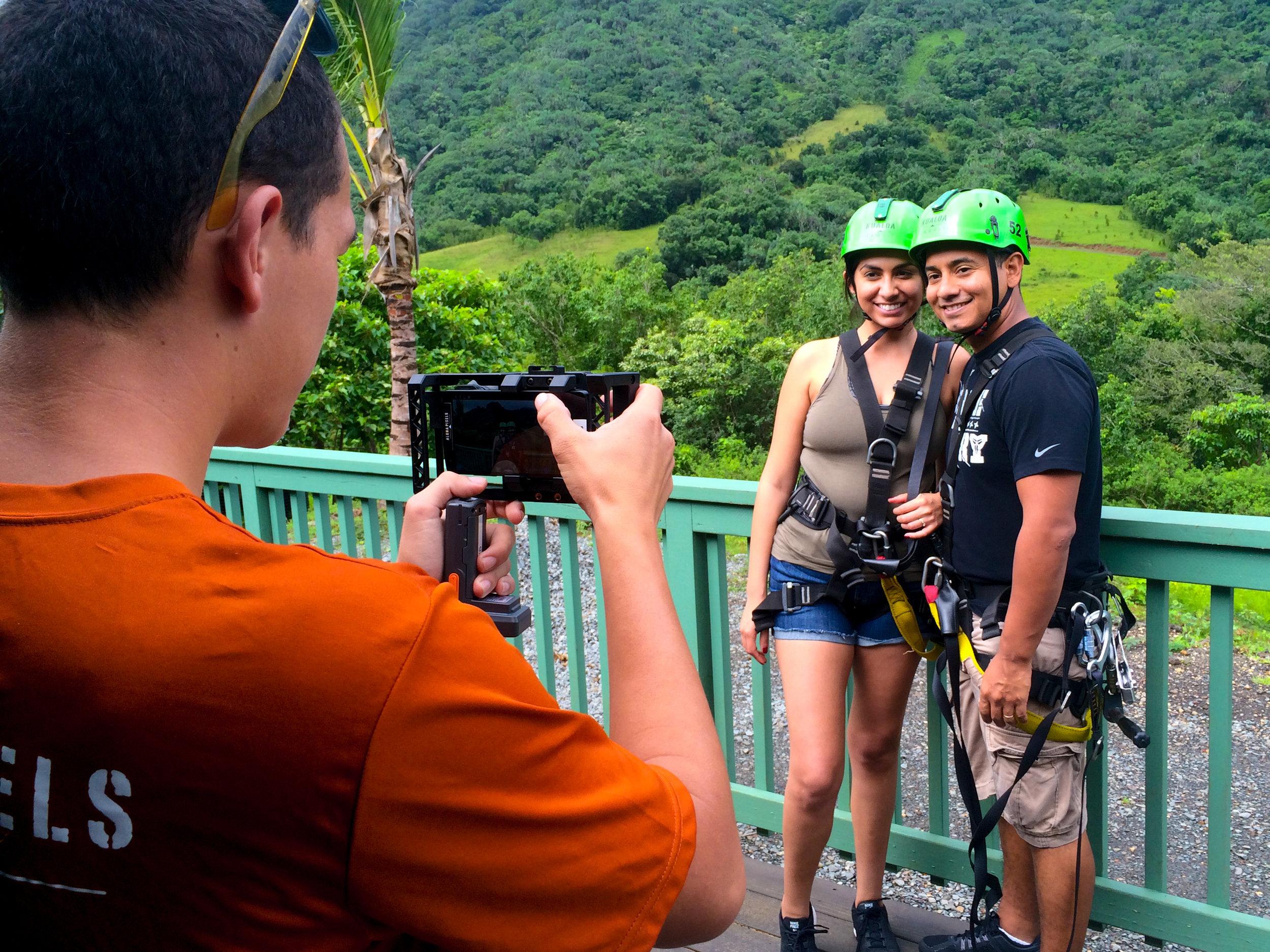 - Zipline staff taking photos of a couple at Kualoa Ranch, Hawaii.
