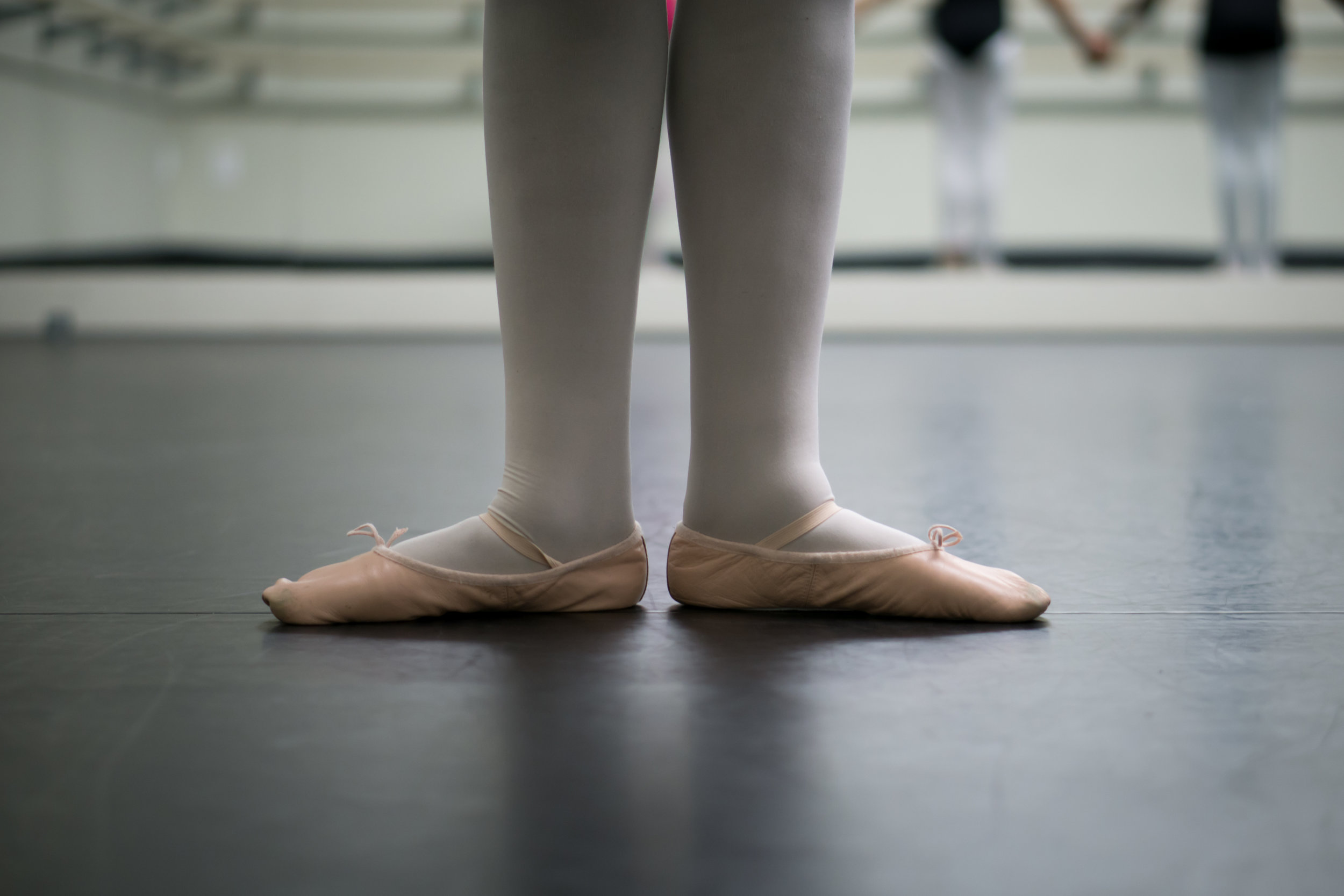 young student in ballet slippers