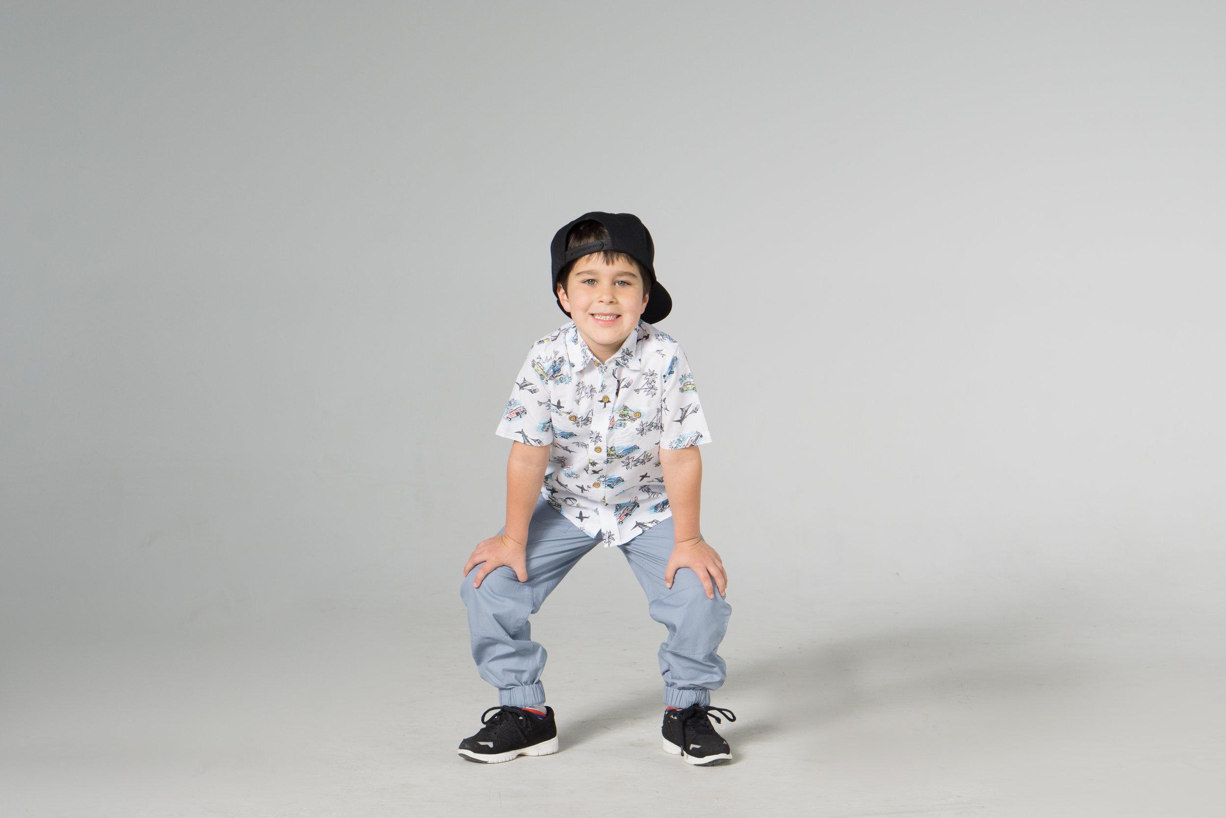 young boy looking happy in hip hop