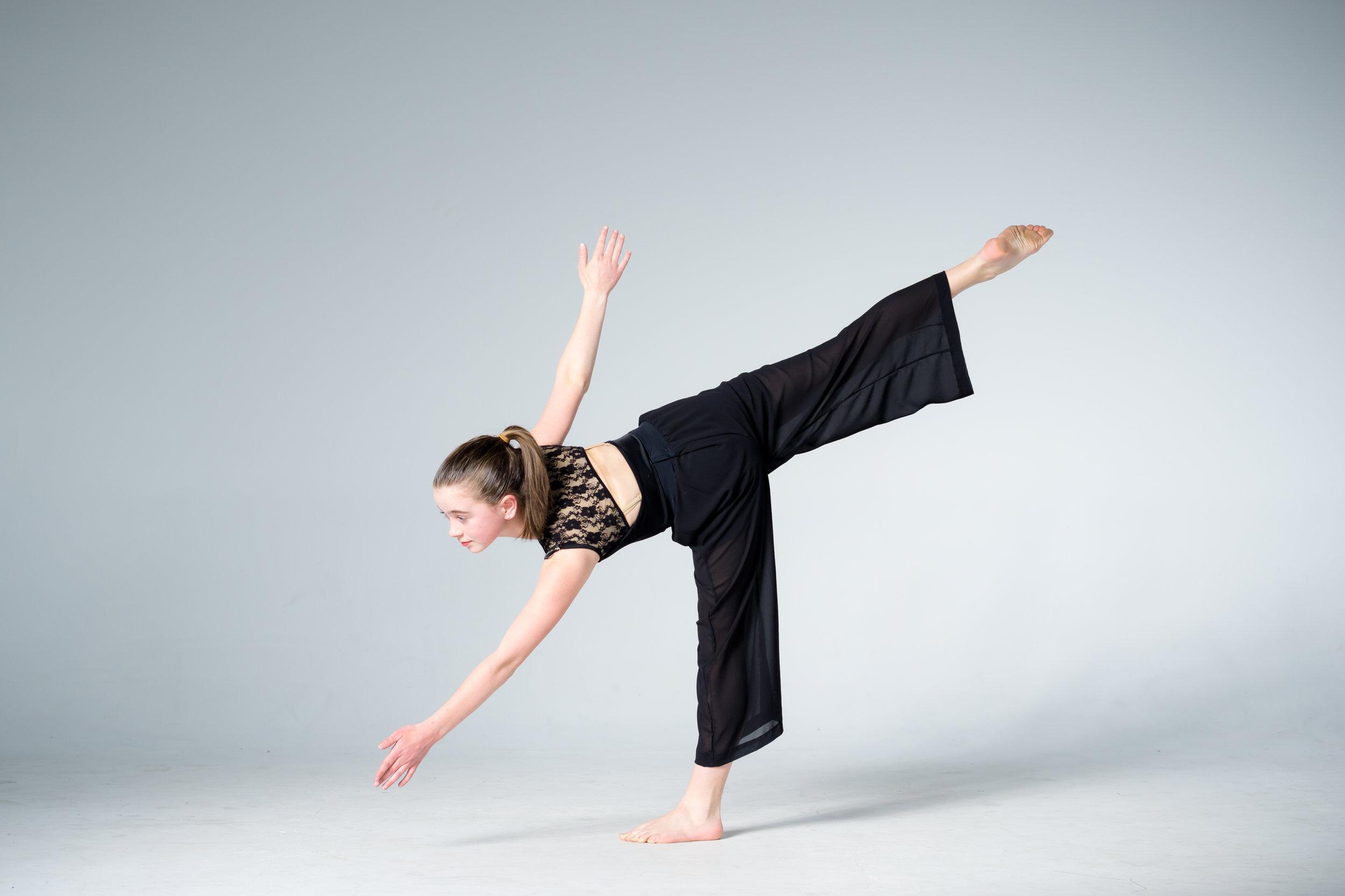 young modern dancer balancing on one leg