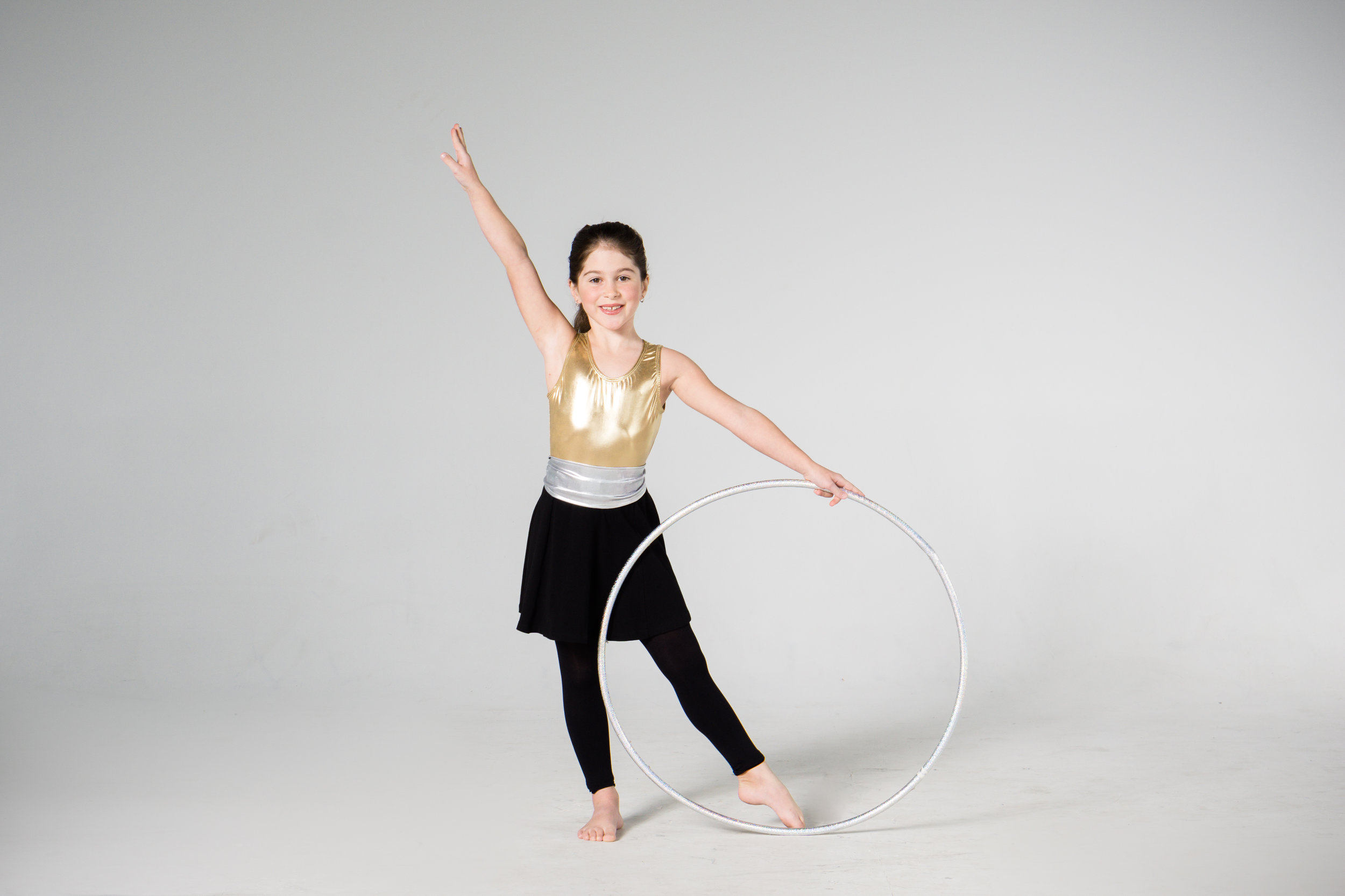 young rhythmic gymnastics girl with hoop