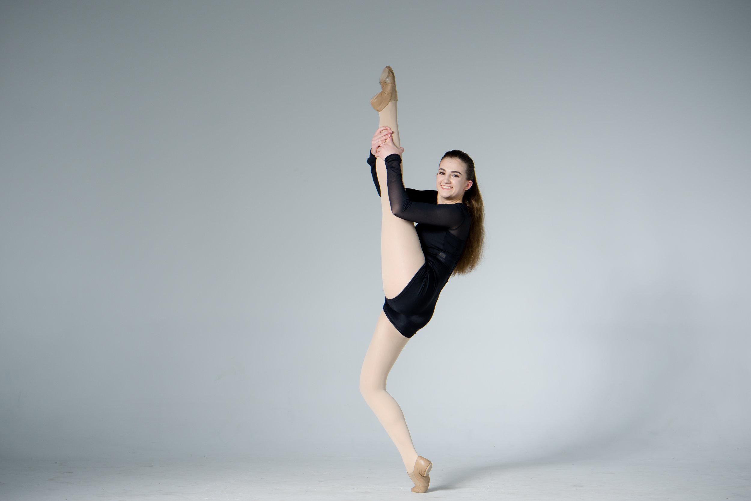 flexible jazz dancer with high leg kick