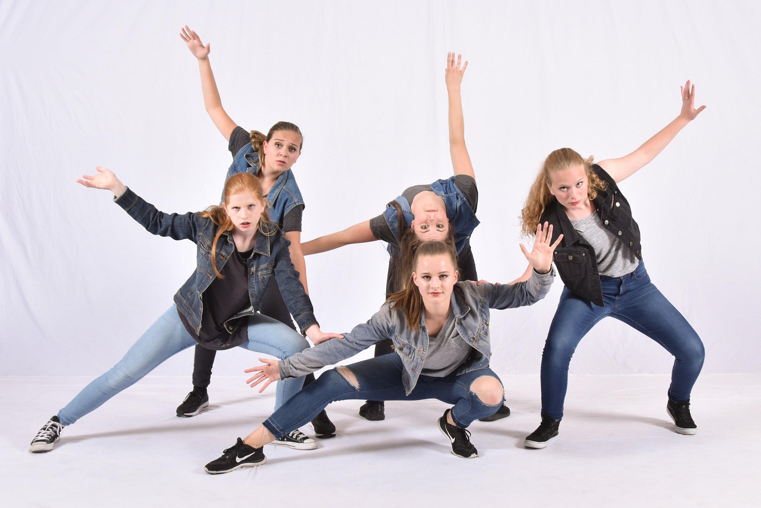 cool hip hop dancers in denim group pose