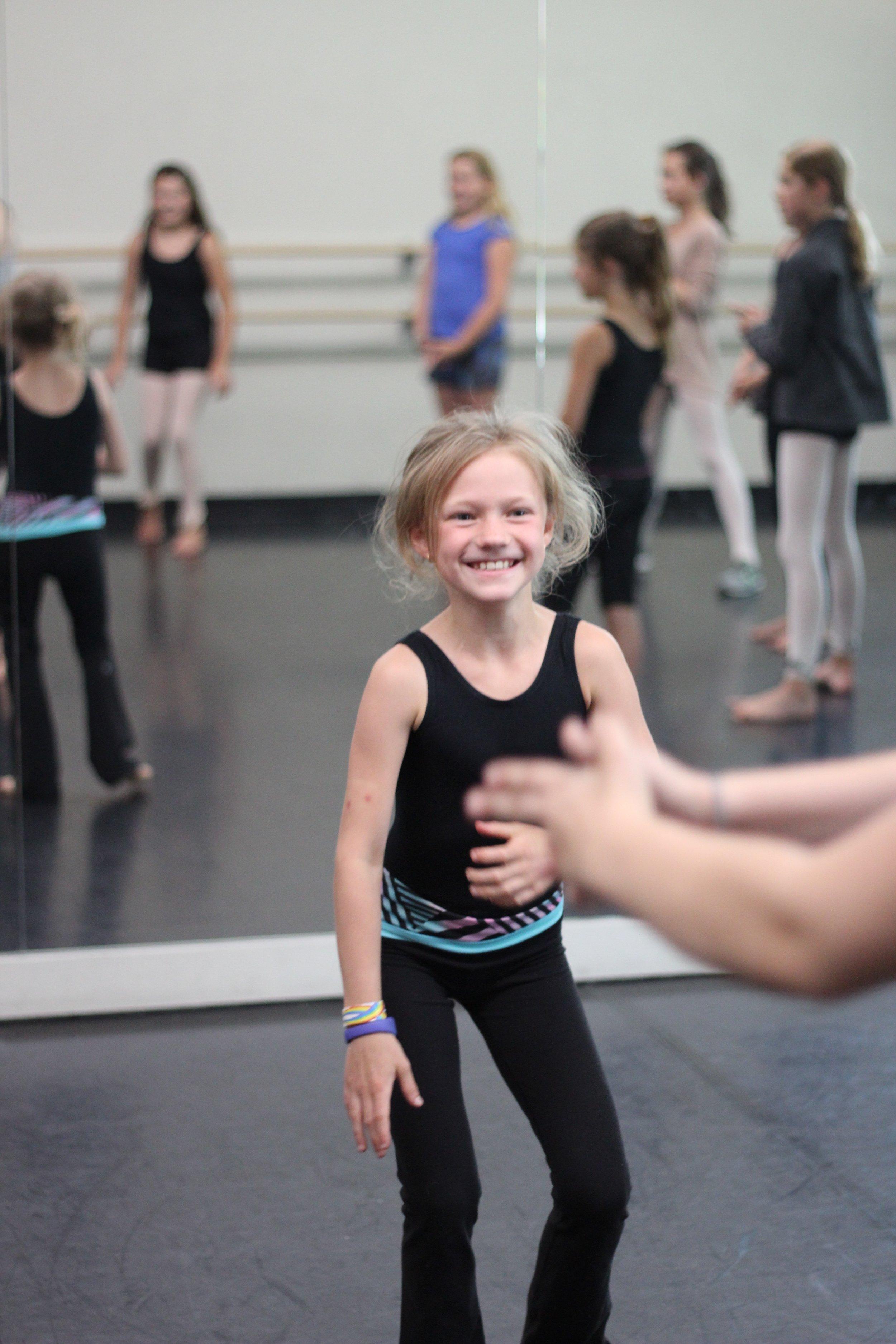 happy girl in dance studio