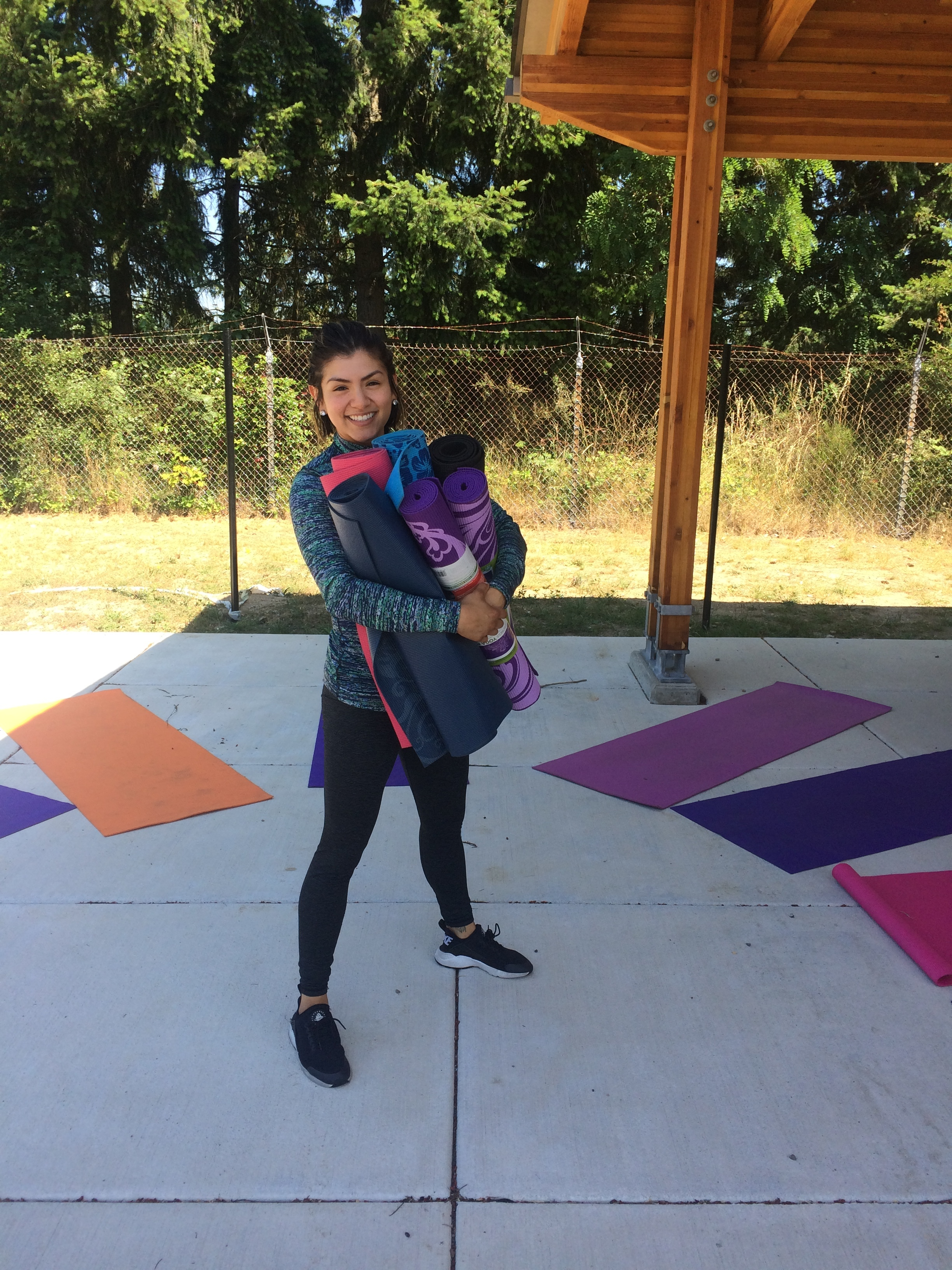 Pictured: Maria with the yoga mats she gifted the children at the Rescue Mission, a refuge for families that have no place to turn.