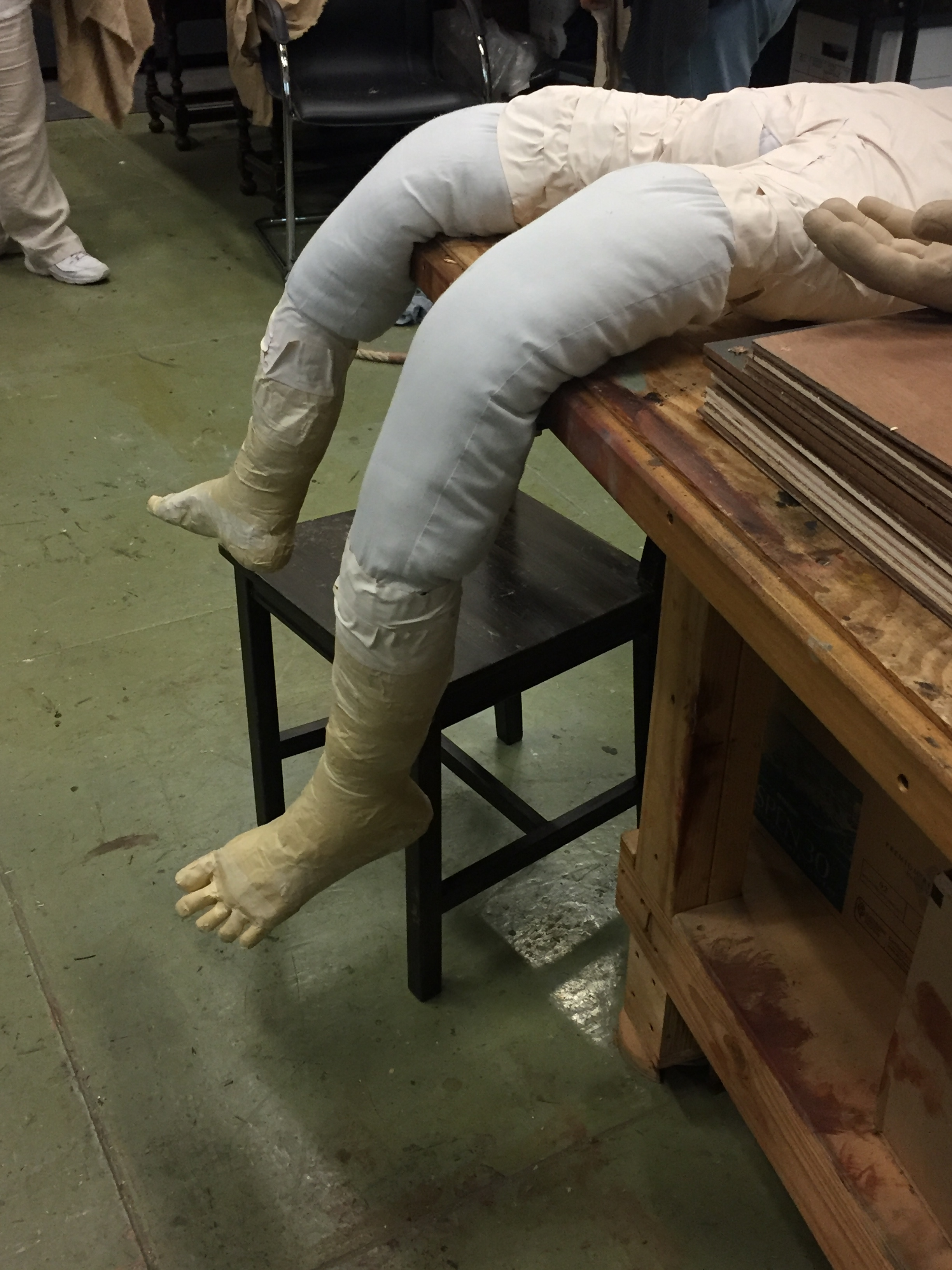 Putting the feet on the fake body