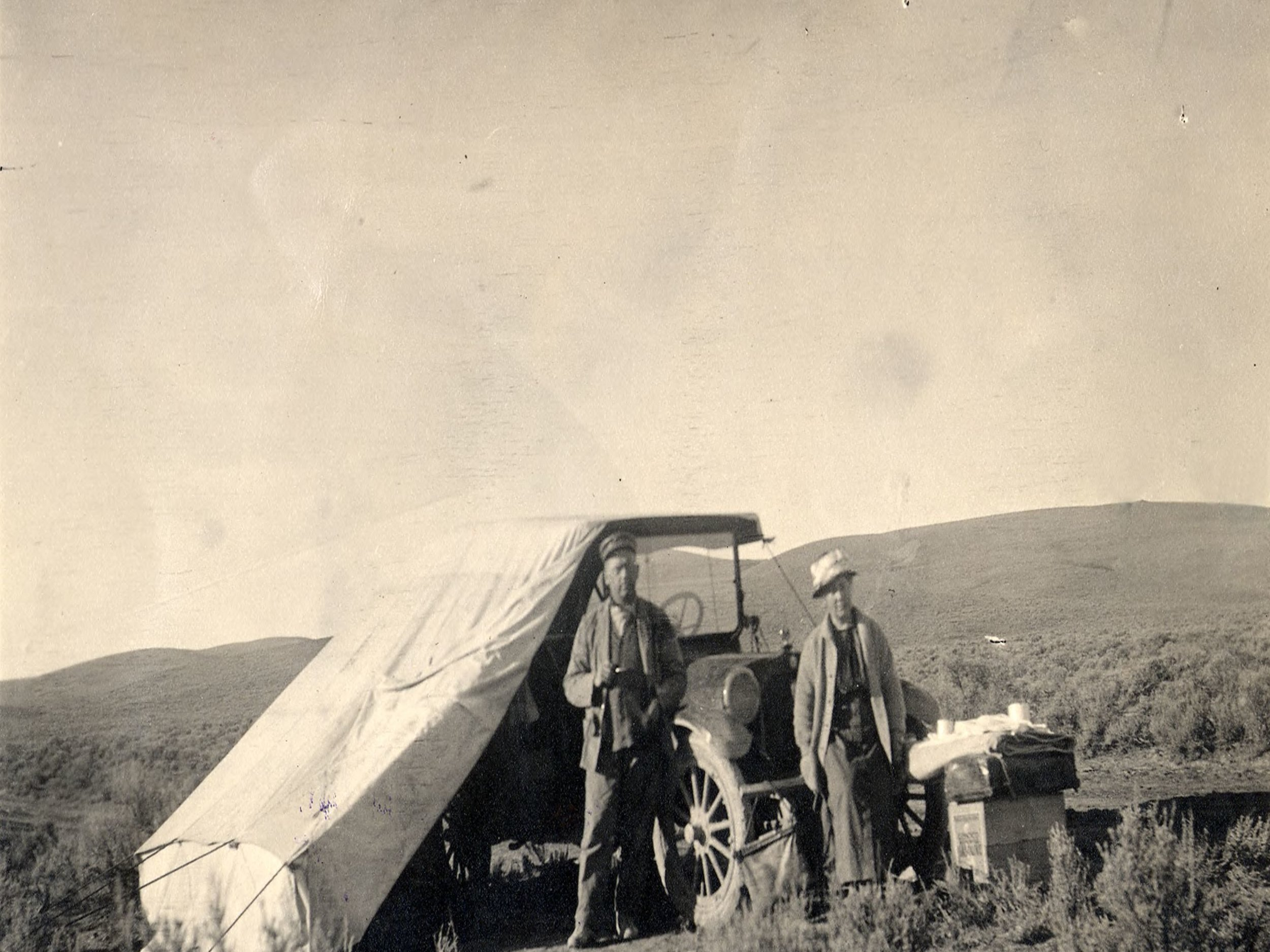 Camping, 1914, showing a pre-WWI automobile outfitted with a tent.  Image/ Special Collections Department, University of Nevada, Reno, Libraries.