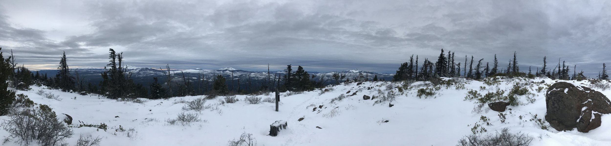 Knee deep snow, gray skies, and a howling wind from the top of Black Butte.