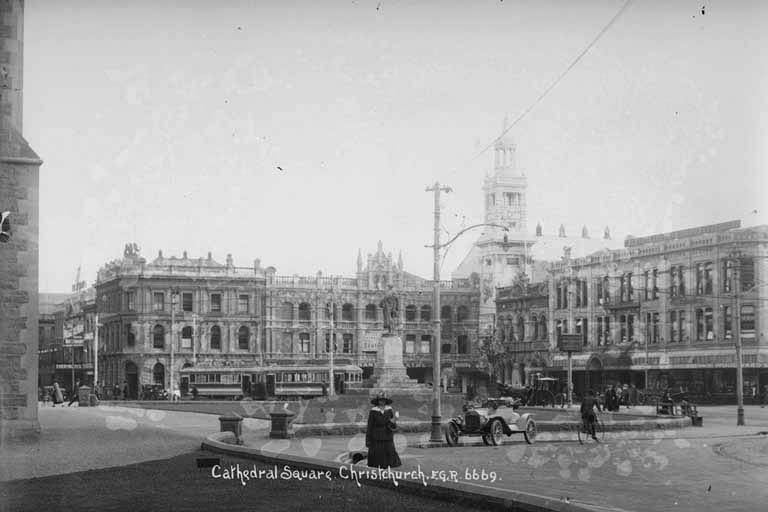 Looking west north west from beside Christ Church Cathedral (foreground, extreme left) in Cathedral Square near the Godley Statue, circa 1918.