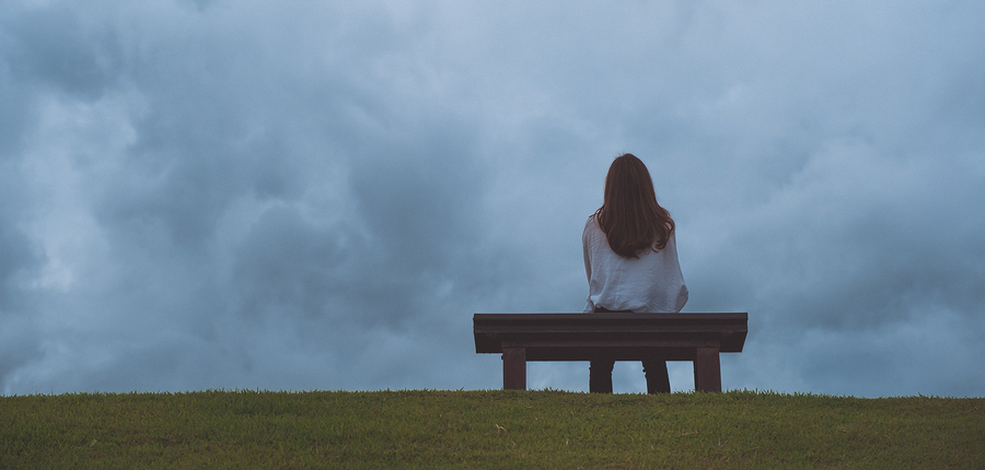 bigstock-A-Woman-Sitting-Alone-On-A-Woo-248874154.jpg