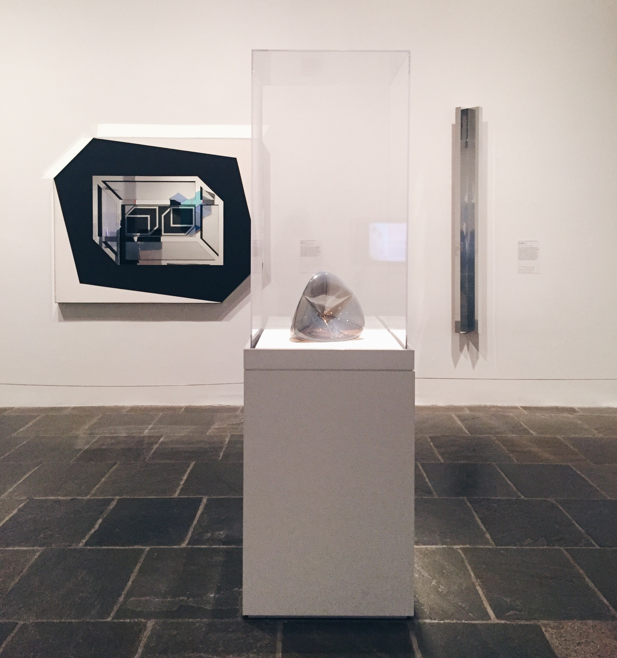 Left to right: Larry Bell,  Untitled . Ruth Volmer,  Steiner Surface