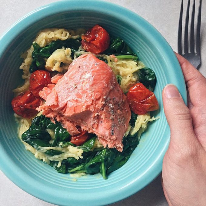 "Sous vide salmon with roasted tomatoes, spinach, and spaghetti squash ""alfredo"""