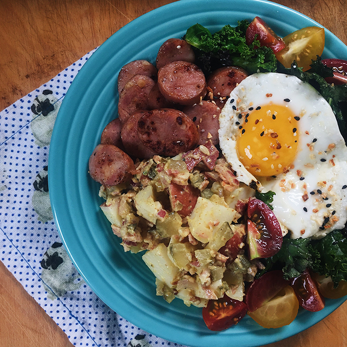 """The potatoes made for good leftovers! I added some to my """"breakfast salad"""" with Aidell's Chicken Apple Sausage, sautéed kale, pastured eggs, and lil tomatoes."""