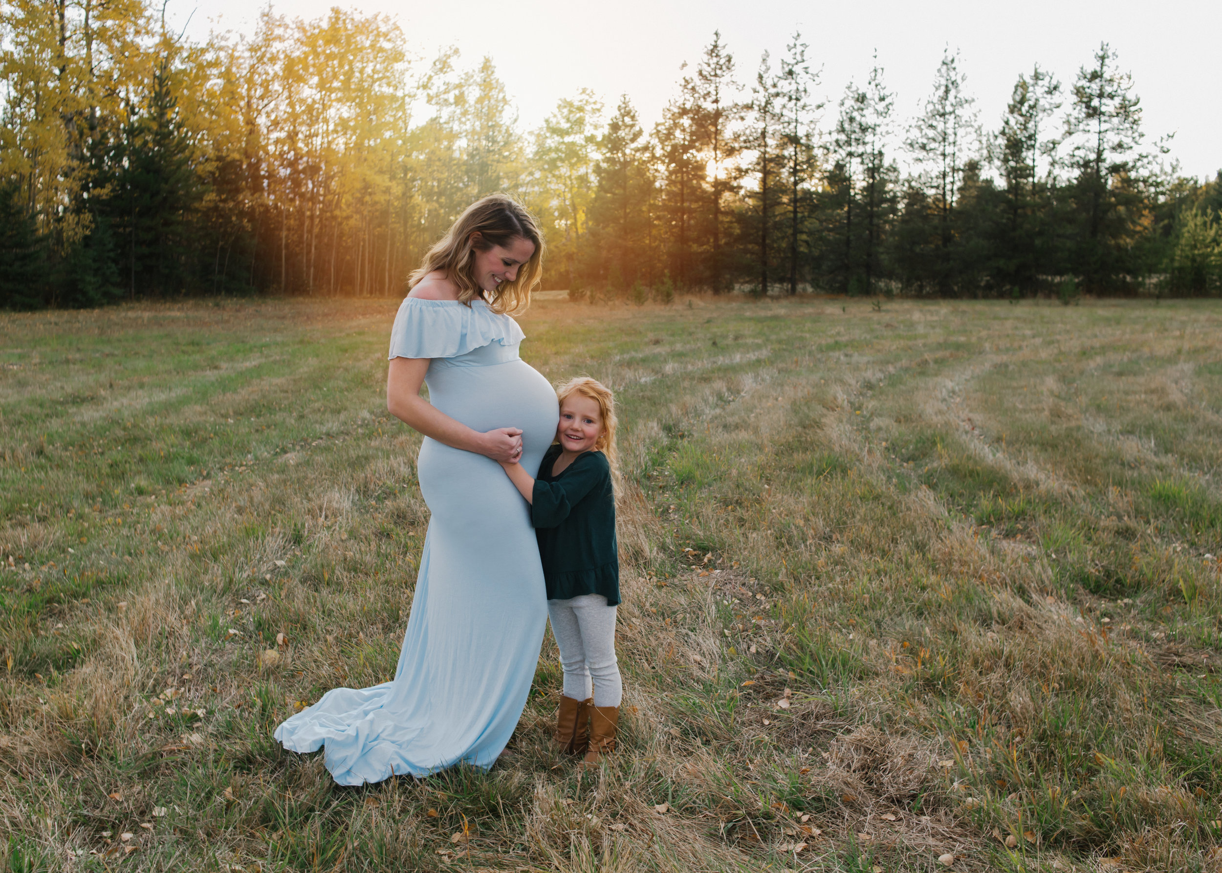 Maternity Session $325 + GST - This session is about one hour. Spouses and siblings are welcome to join in. Fabrics and gowns available to use. 25+ digital images via digital download are included.
