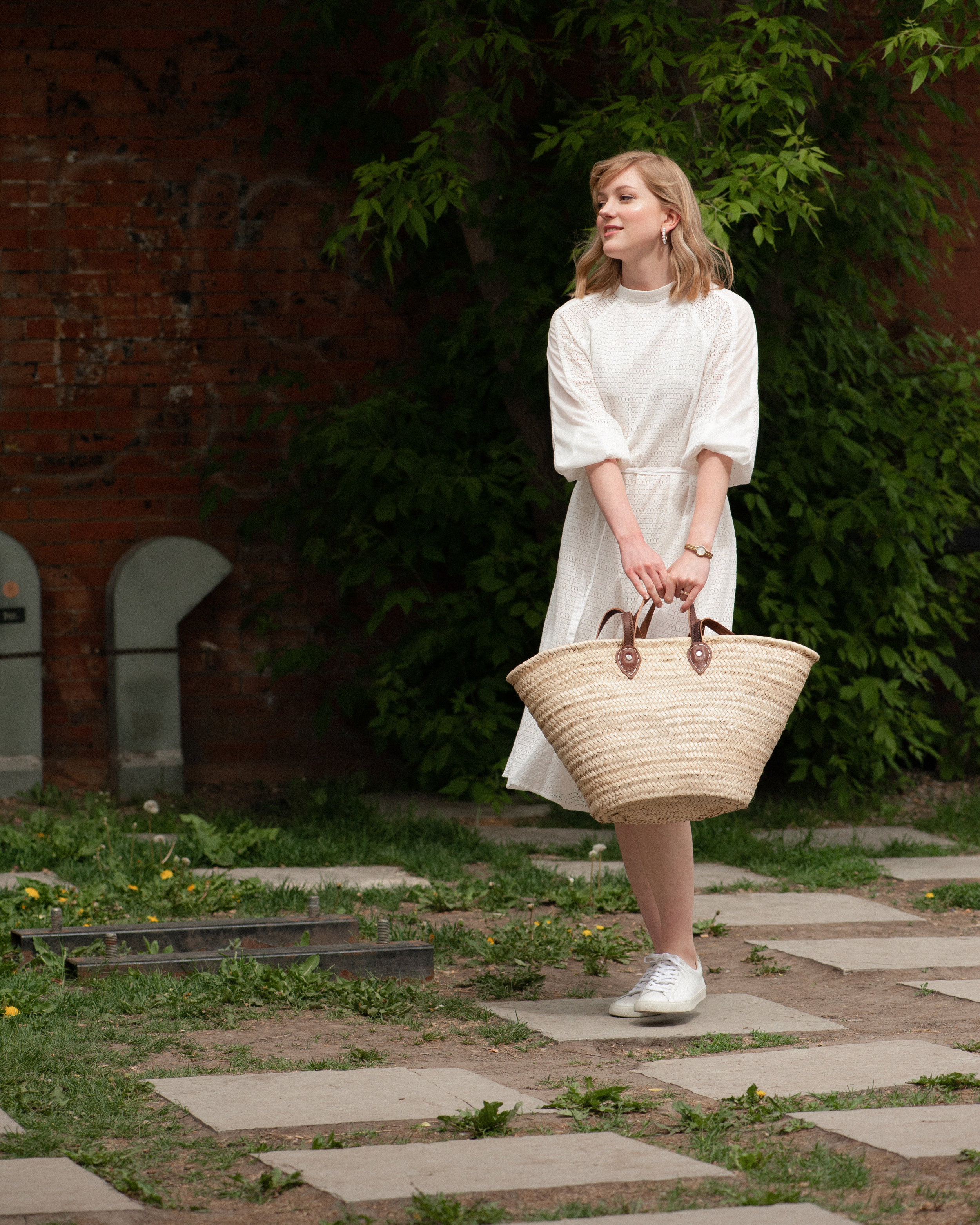 Photography by    Suzanne Nolan   . The Lyon Dress by SKYE. Bag: June Home Supply. Shoes: Veja.