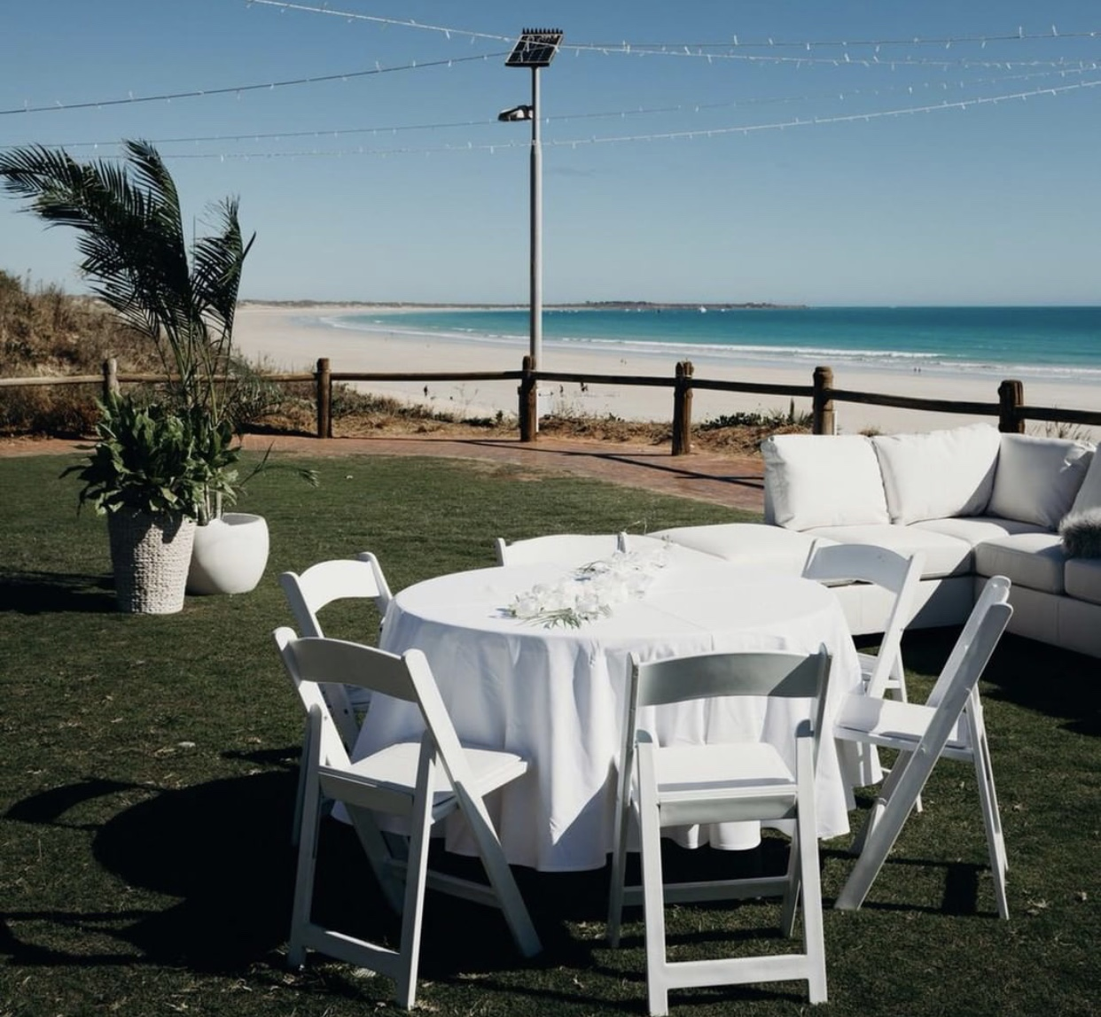 White Chairs: $10 each - Perfect for your beach or garden ceremony or a sit down receptionPhoto by Julia Rau