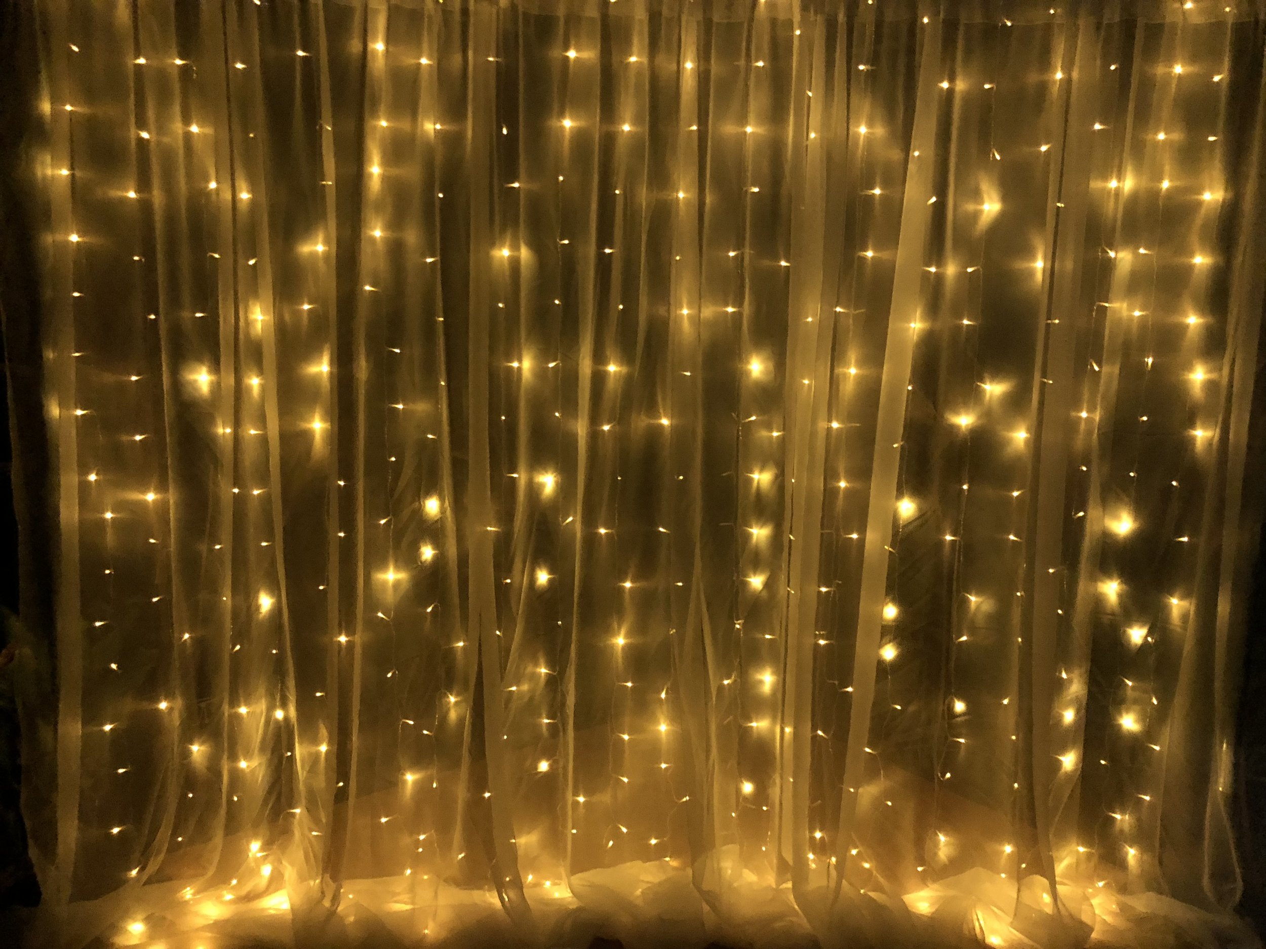 Fairy light curtain: $120 - Perfect for behind bridal table, desserts bar or as a magical backdrop. 462 LED Warm White curtain backdrop 3M x 3M . Price includes stand and set up. Can be hired without curtain