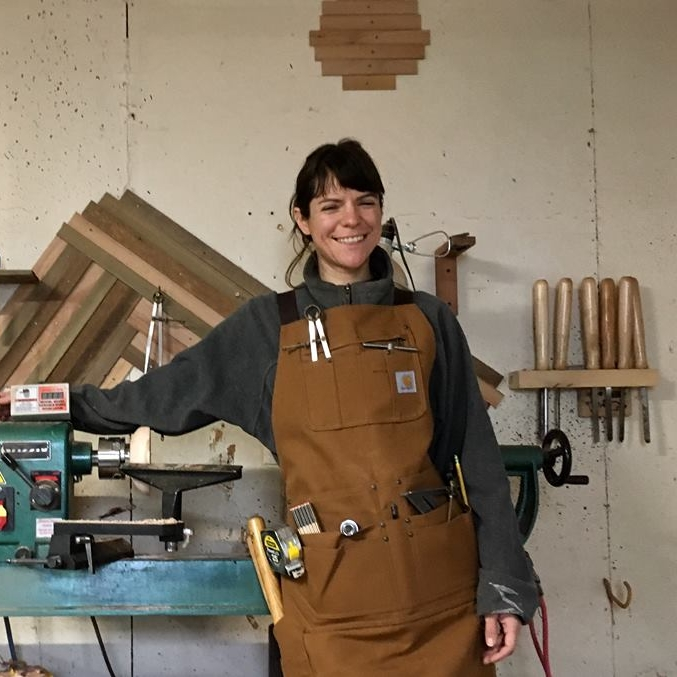 Julie Jackson Surcle  - Julie sources wood from old barns, old buildings, and fallen trees to create wooden home decor, capturing the natural beauty of wood into a functional product. Her products include turned wood lamps, wood light pendants, and custom furniture.