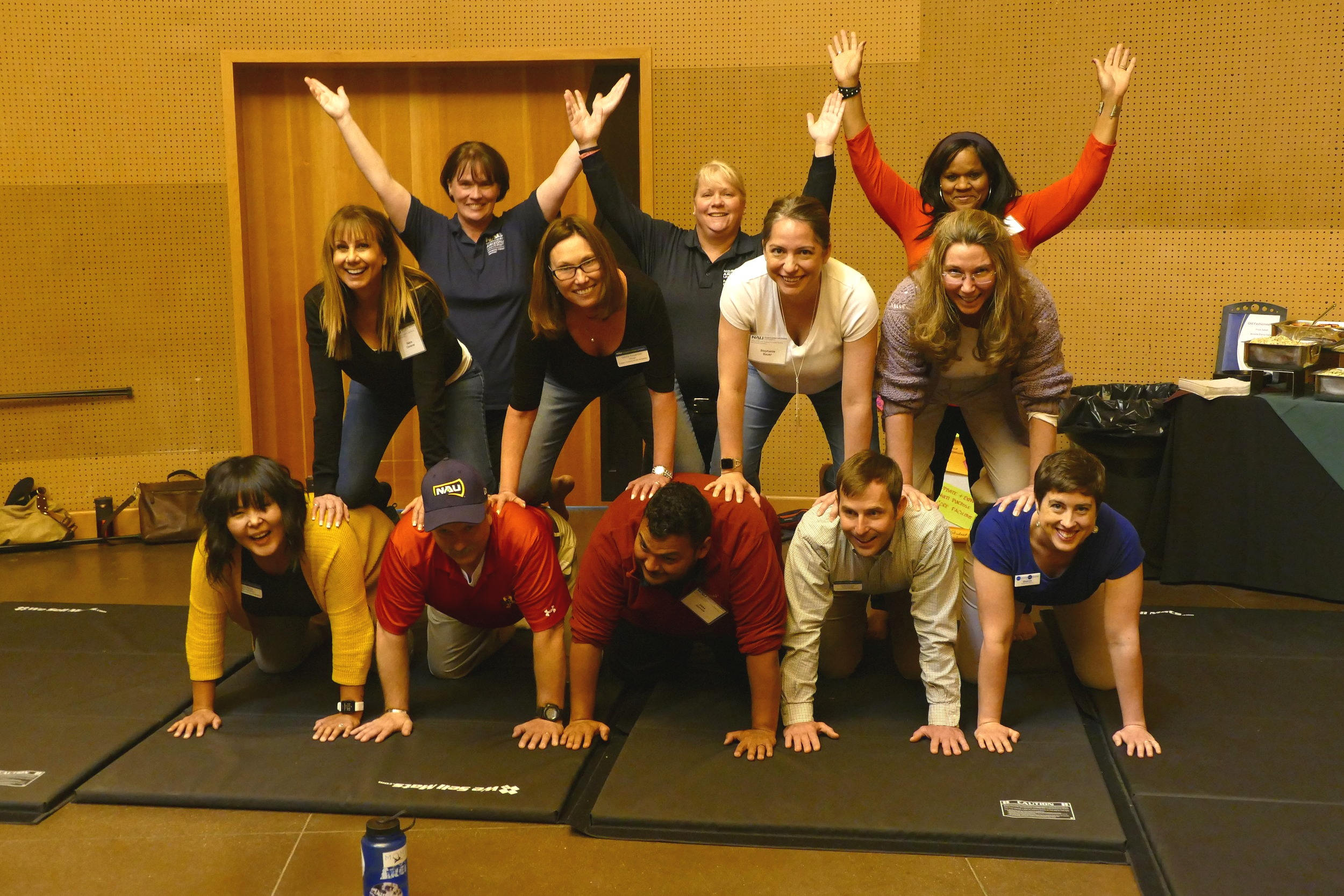 CAPCOT members build a pyramid. For many of any of these professionals, this was their first time ever doing acro balance. They did great!