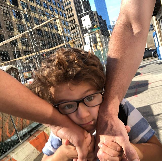 """When my kid walks between my partner and I, he often squeezes our hands around his cheeks.  Heart=melt And he didn't even scream """"delete that picture, Daddy!"""" After I snuck the pic."""