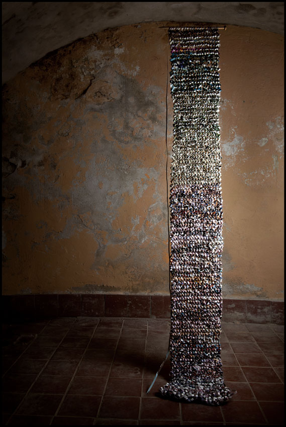 'Knitted Shreds', (shredded photographs, staples, knitting needles), 2012.
