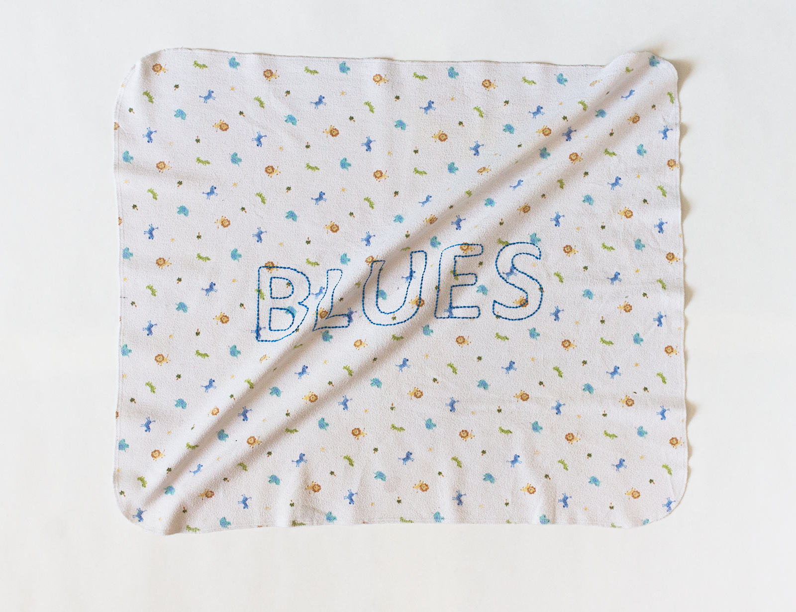 'Baby Blues', embroidery on baby blanket.
