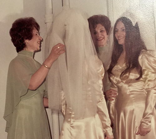 Hilda adjusting the veil she made for Sharon's June 15, 1975 wedding in West Orange, New Jersey - Sharon wore her mother's wedding gown