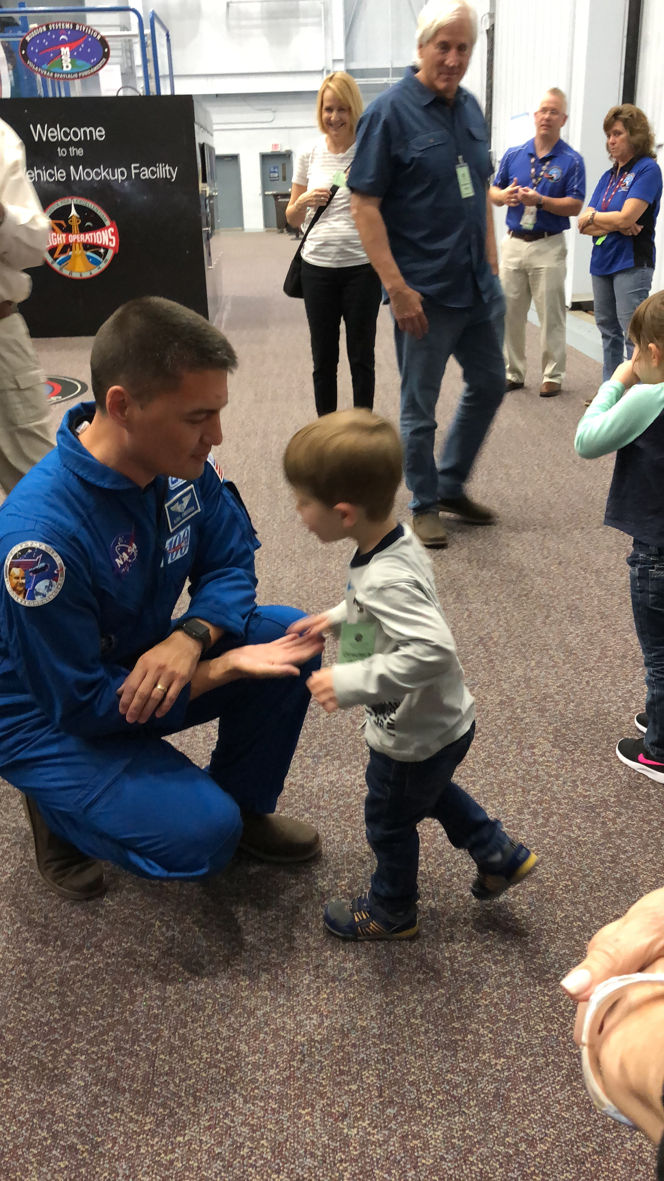 Dr. Kjell N. Lindgren was selected to be an astronaut by NASA in 2009. Here, he is seen with our young cousin Josh Hacker at the Space Vehicle Mockup Facility at NASA in Houston, Texas - October 2018