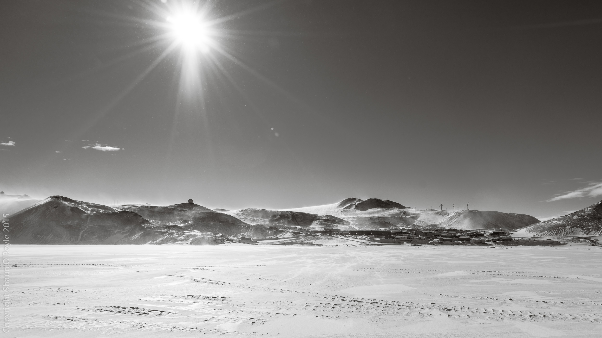 McMurdo Station from Sea Ice. The haze around the mountains is wind blown snow.