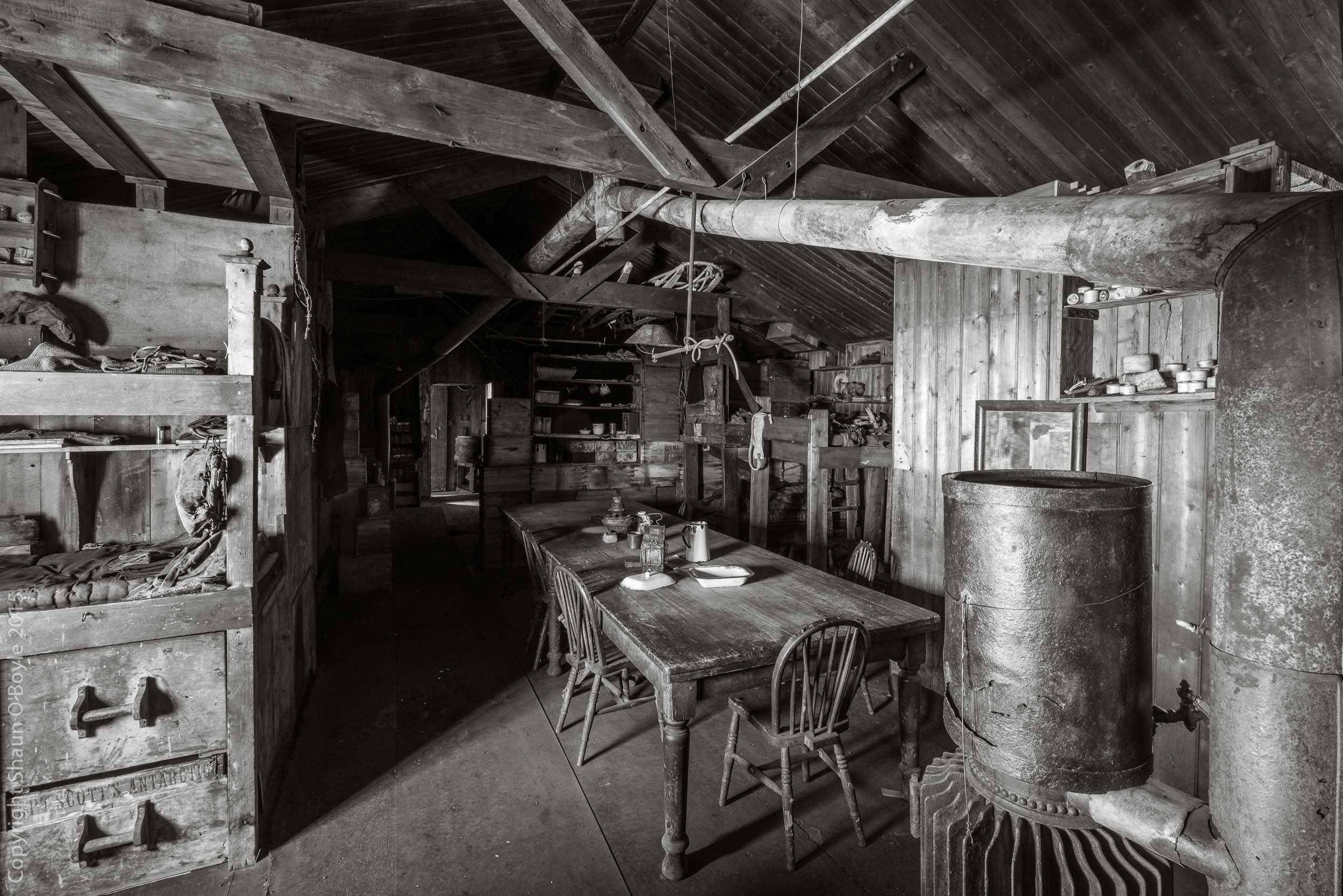 Wardroom Table, Cape Evans Hut. The chair in the foreground is Captain Scott's designated place.
