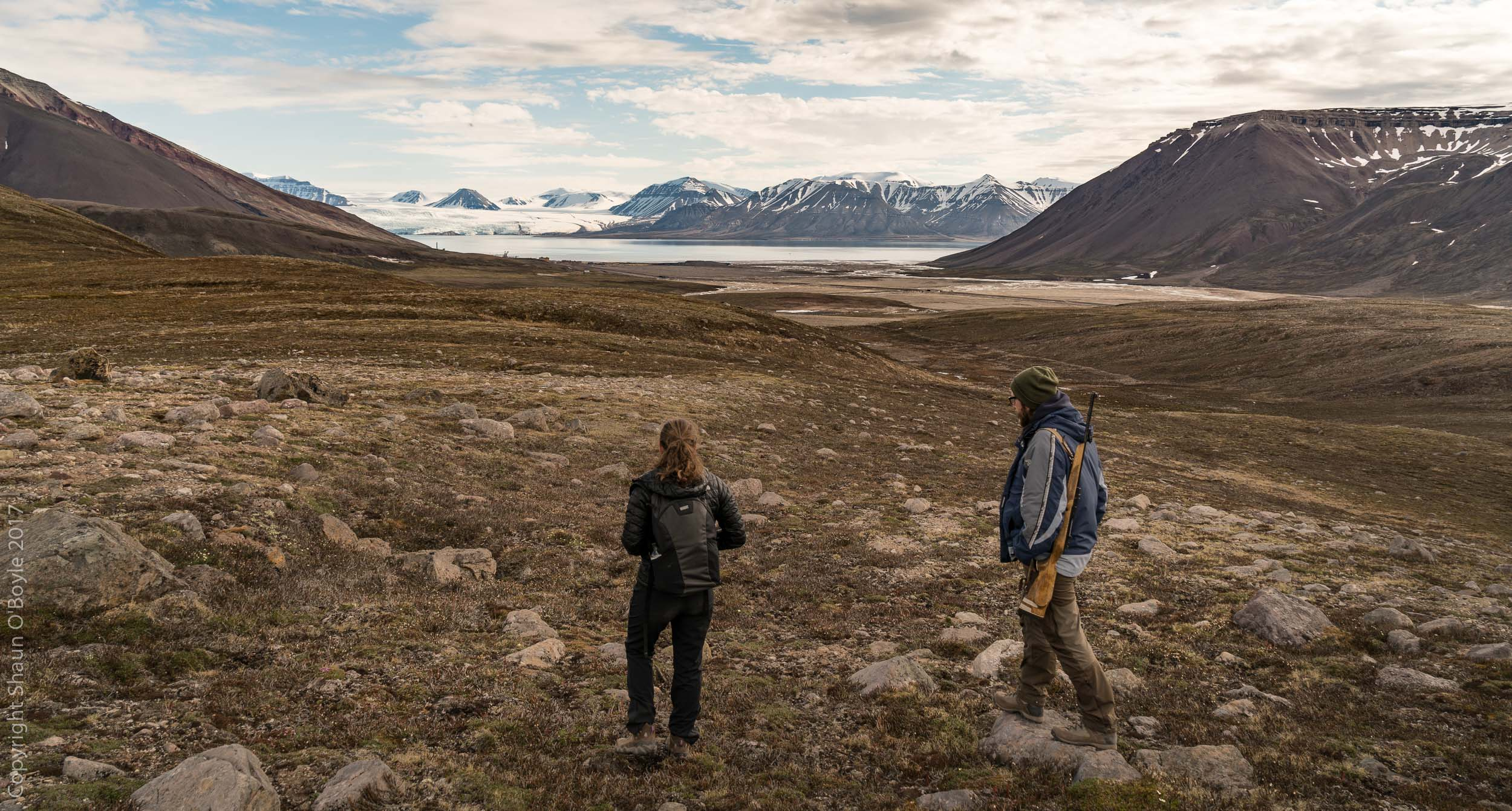 Trekking in the valley above Pyramiden with a Georgian guide. Pyramiden was an active Soviet coal mining settlement from 1927 until 1998 when it was abandoned.