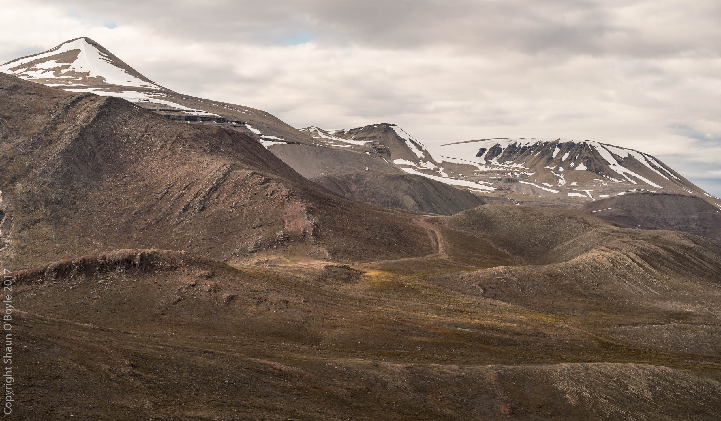 Trekking in the valley above Pyramiden, Svalbard