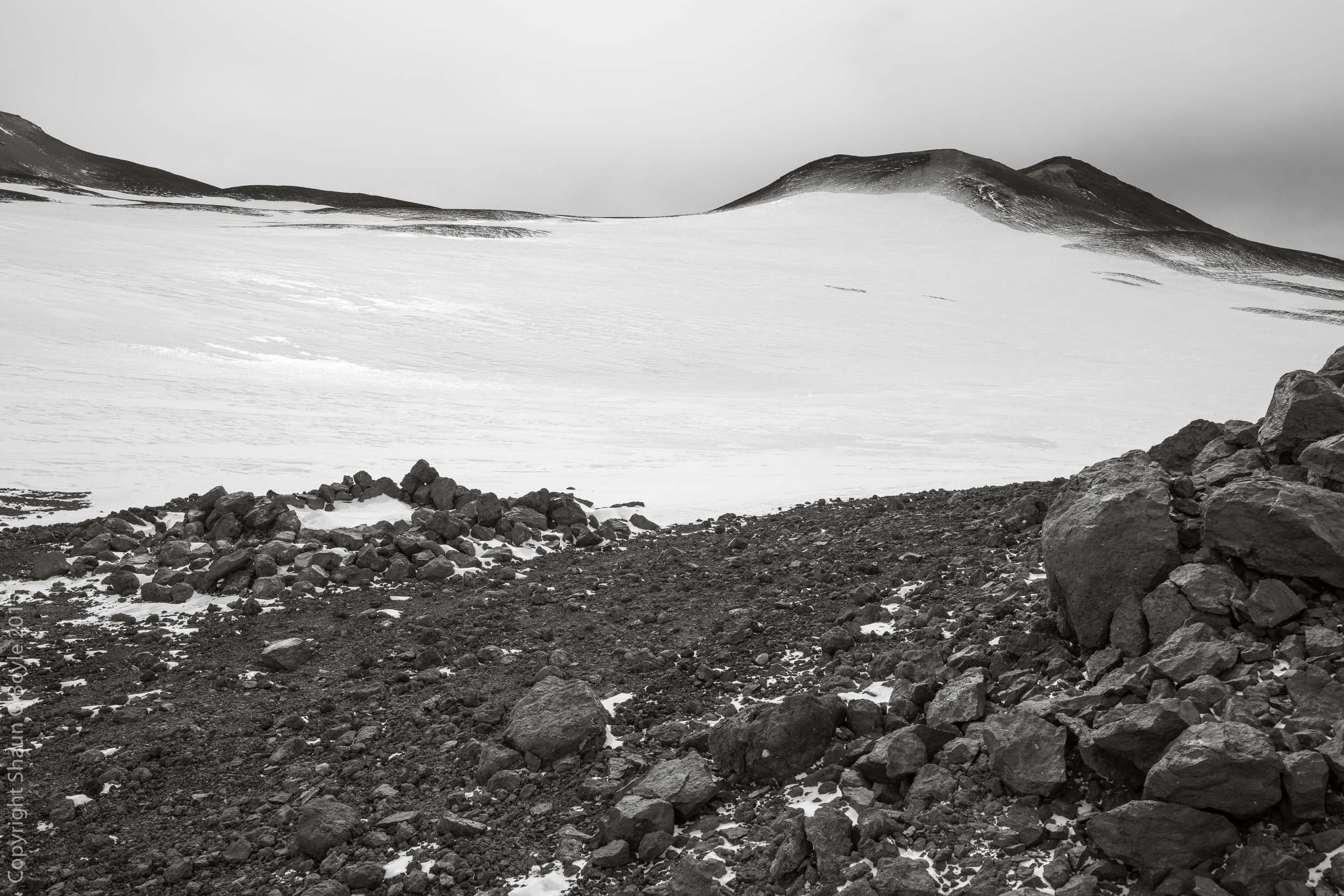 Wilson's Igloo, a stone igloo built by Edward Wilson, Birdie Bowers and Apsley Cherry-Garrard during the 1911 Worst Journey in the World expedition. At that time the only known emperor penguin rookery was located at Cape Crozier, and they were attempting to collect emperor penguin eggs for study.